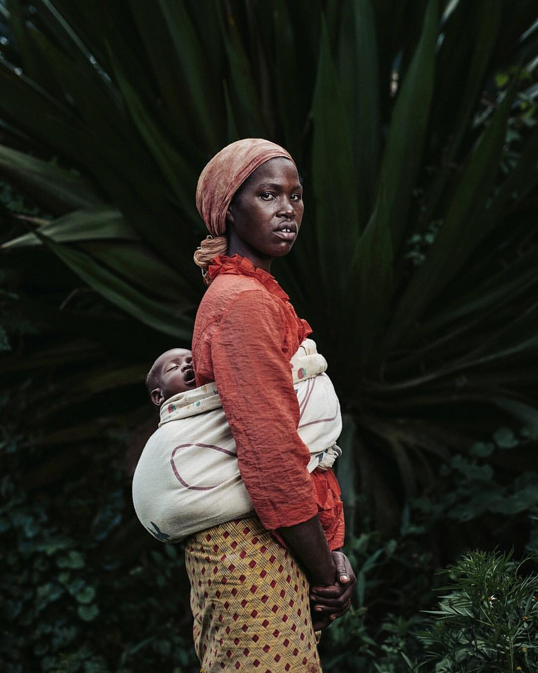 A woman carries her baby in Rwanda.