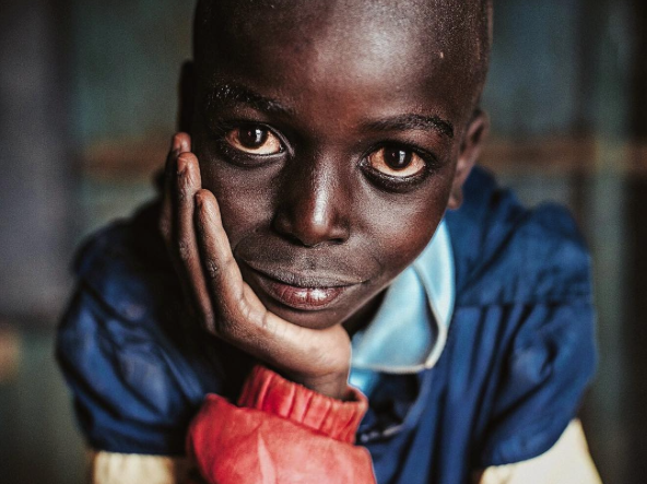 A young orphan stares into my camera in Kenya.