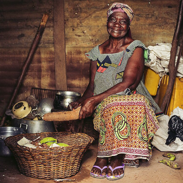 A grandmother makes dinner for her family outside Kumasi, Ghana.