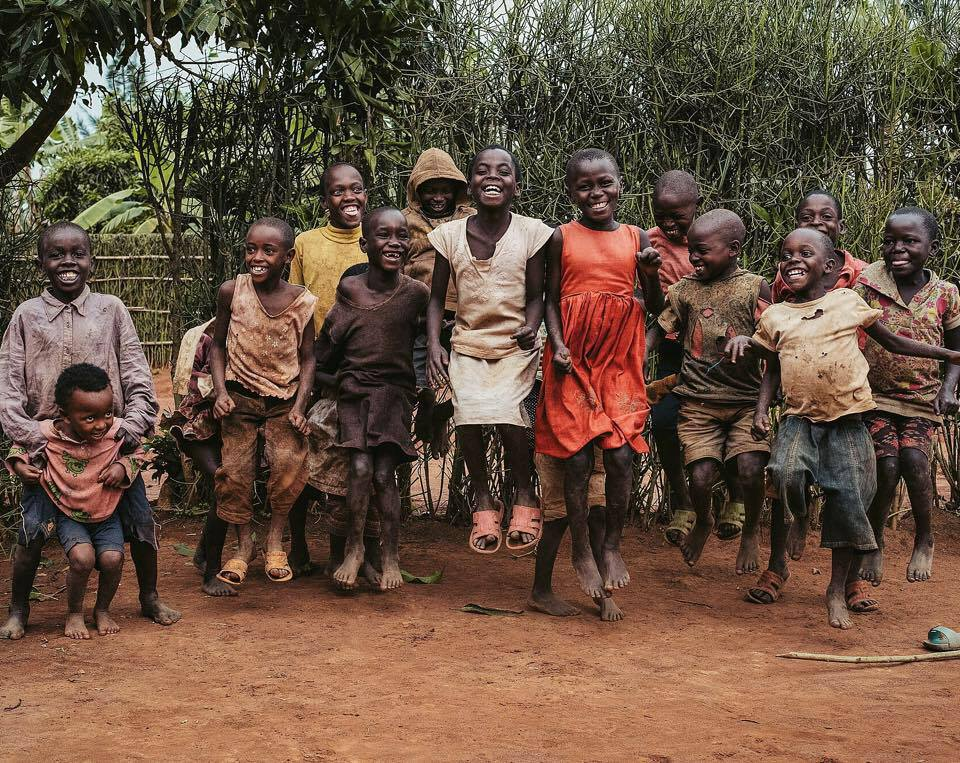 Children in Rwanda jump for joy.