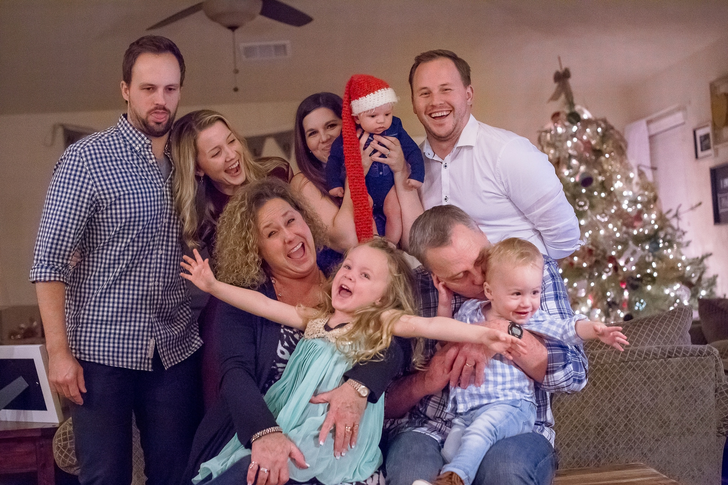 This pic was taken on Christmas Eve of Jess and I along with my brother Bryan, his wife Shanna and their 2 month old son Ethan. My parents were the lucky ones who got to hold our crazy kids.