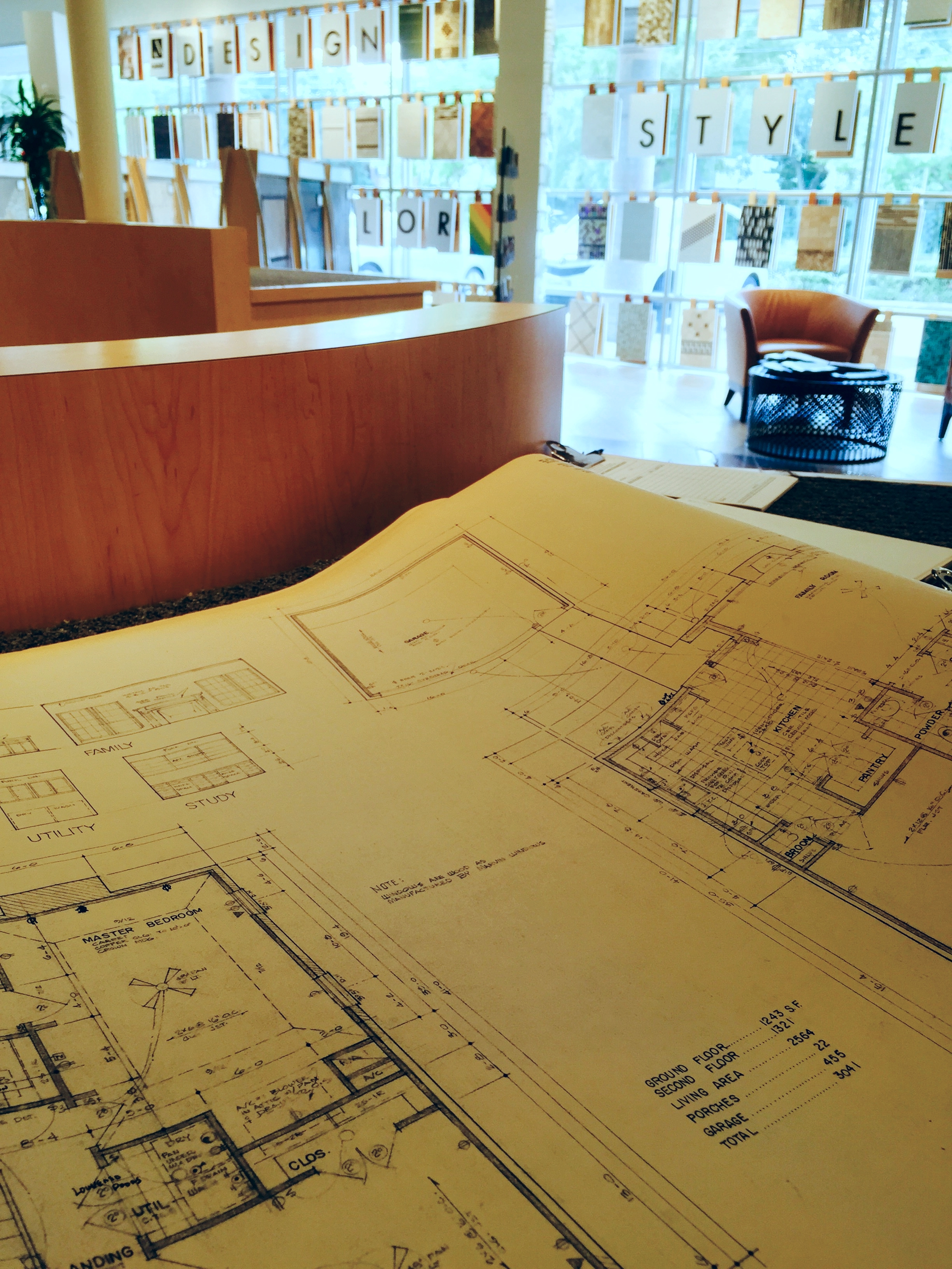 Checking out our original 1986 floor plans while looking at tile options.