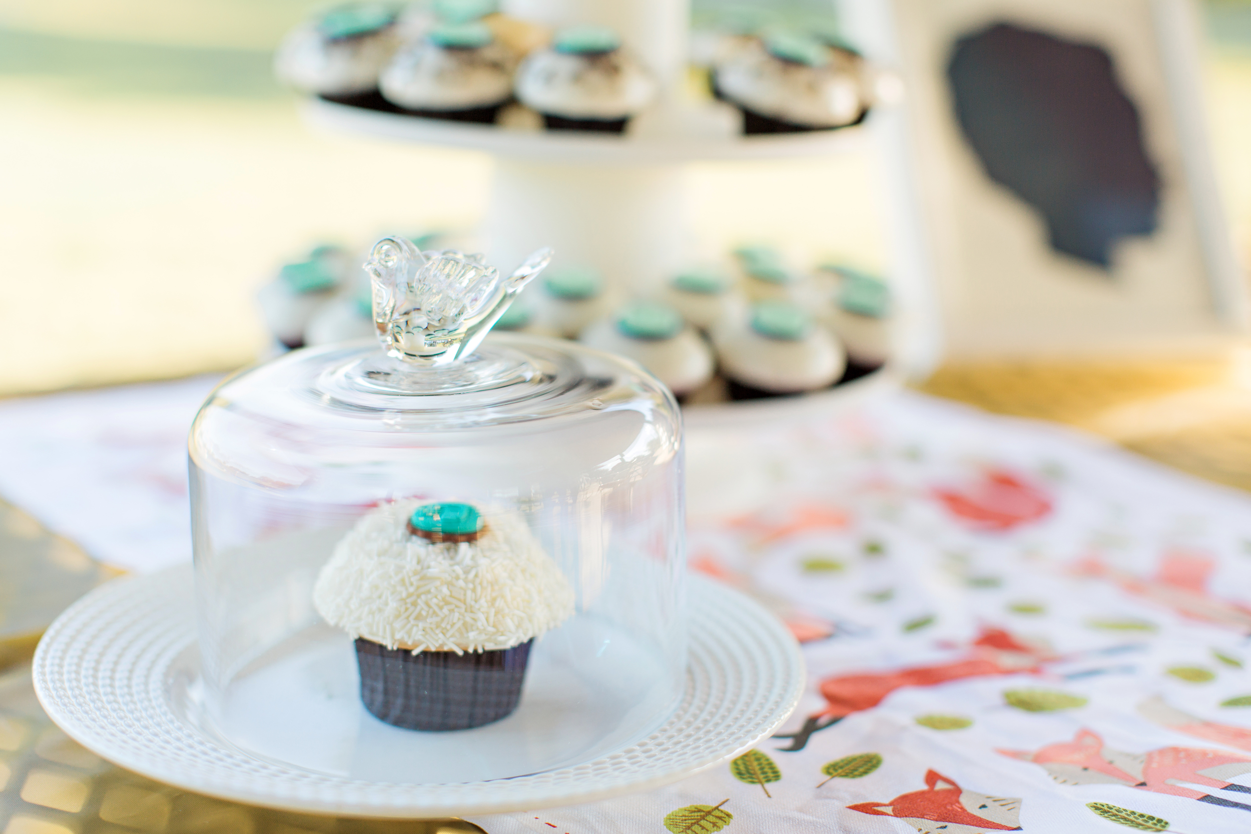 Cupcakes by  Crave . Photo by  R&J Studios .