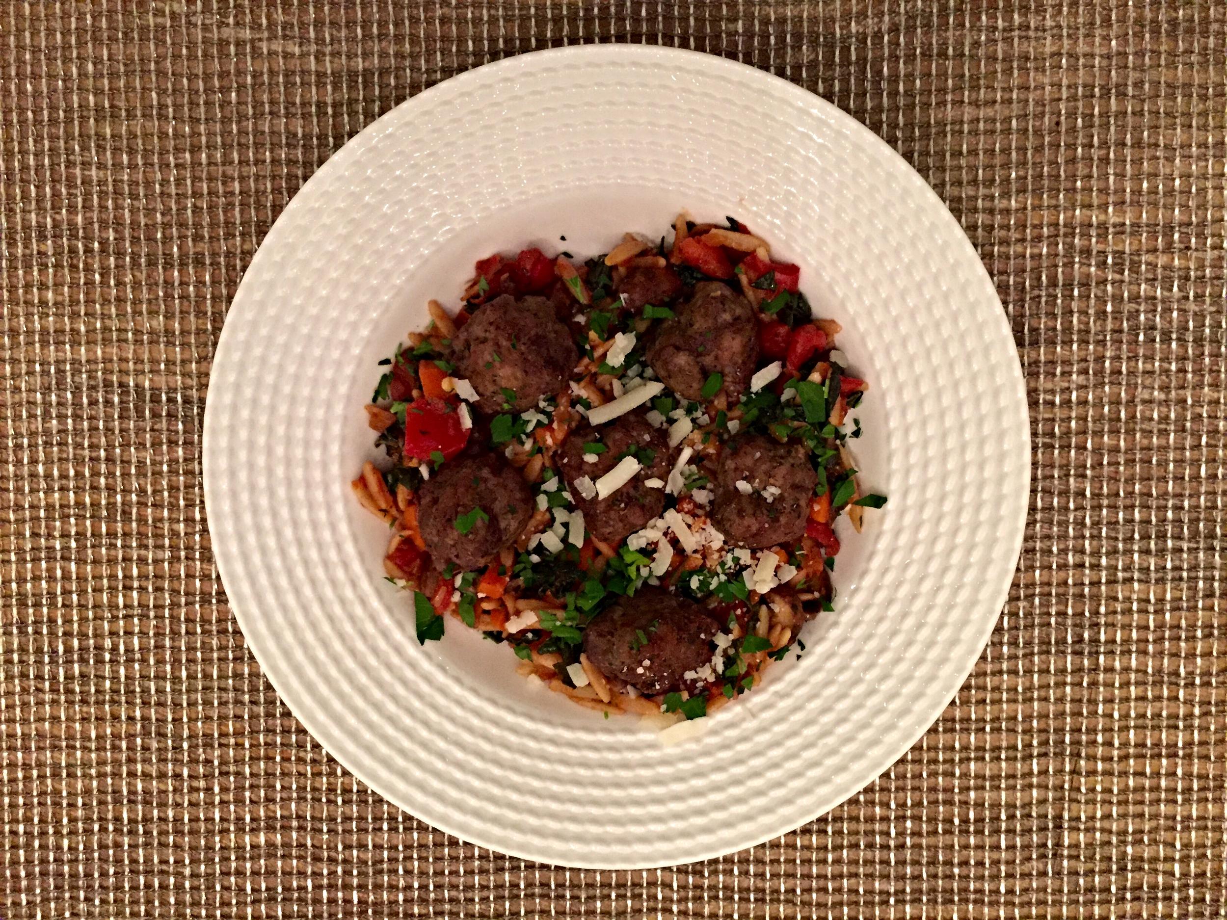Italian Meatballs , orzo pasta, mushrooms & kale,tomato sauce