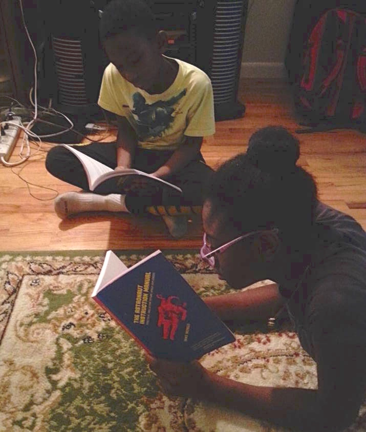 Jaden & Destiny reading The Astronaut Instruction Manual