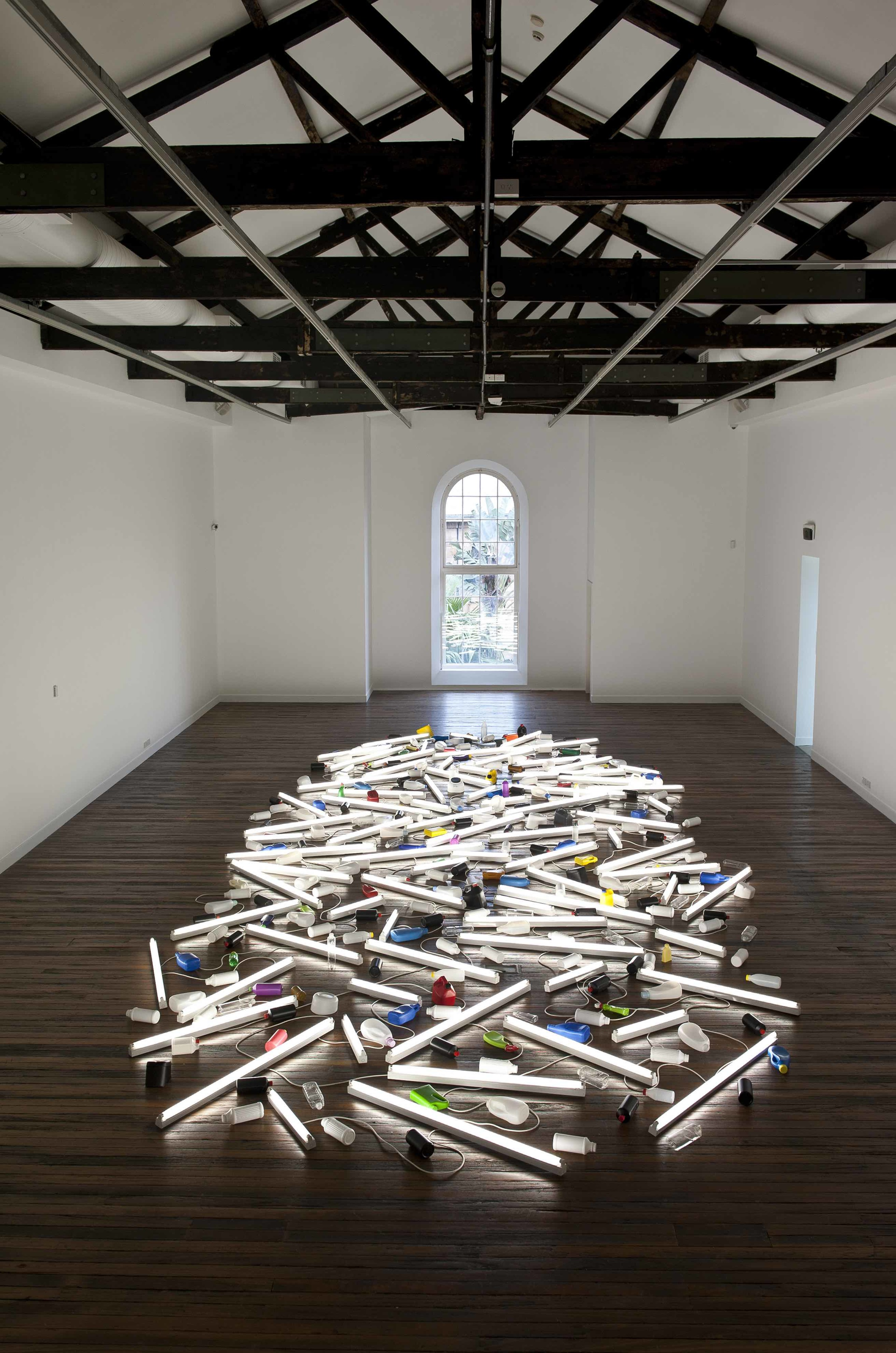 Bill Culbert in January this year at NAS Gallery. Image caption is Bill Culbert  Pacific Flotsam  (2007) installation view, NAS Gallery January 2015 Photo: Peter Morgan.