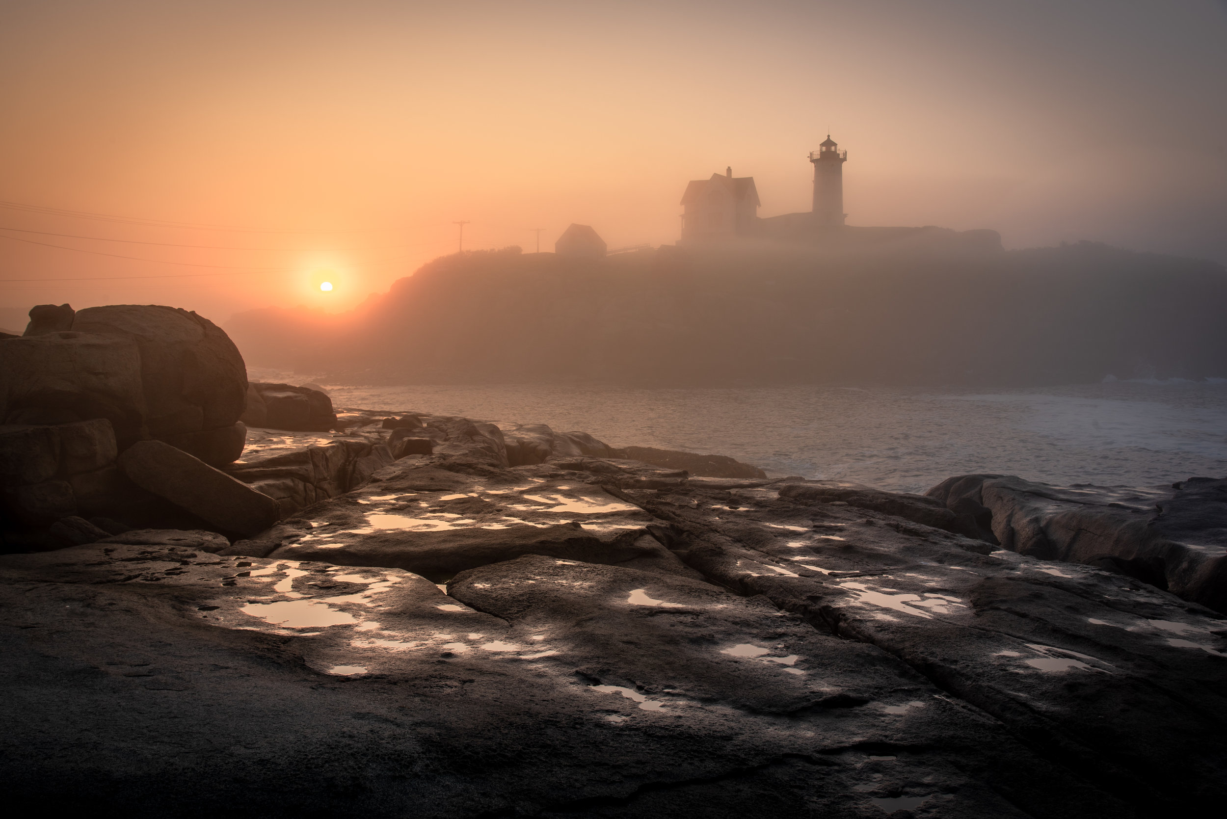 The Sun peeks over the ridge of the rocky shores of Cape Neddick. The tide slowly rises and crashes against the now illuminated rocks. The sea mist rolls in enveloping myself and the lighthouse. A new day has begun and I am surrounded by all of the elements of nature and it makes me happy and looking forward to things to come.