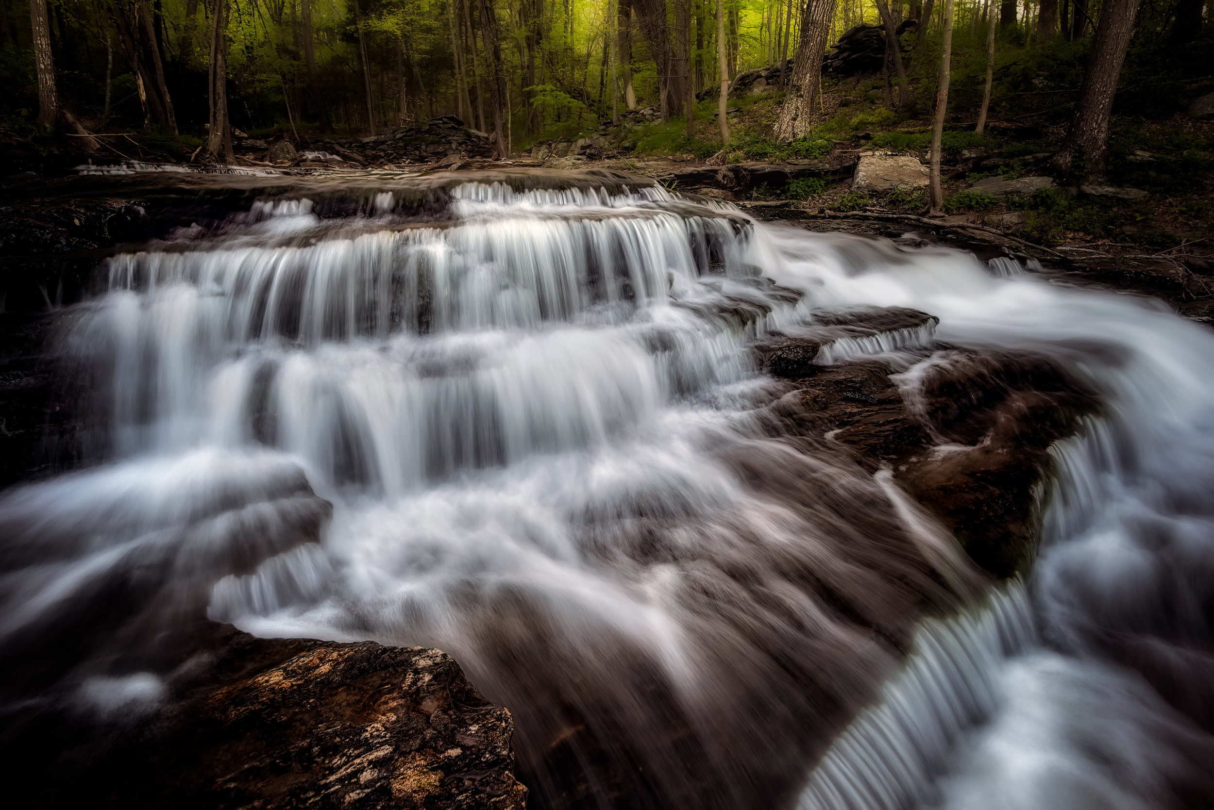 This is about midway up from the bottom of the cascade area facing into the woods away from the road. The 20 mm lens really helps to exaggerate these step cascades. An even wider lens would probably look even more dramatic.