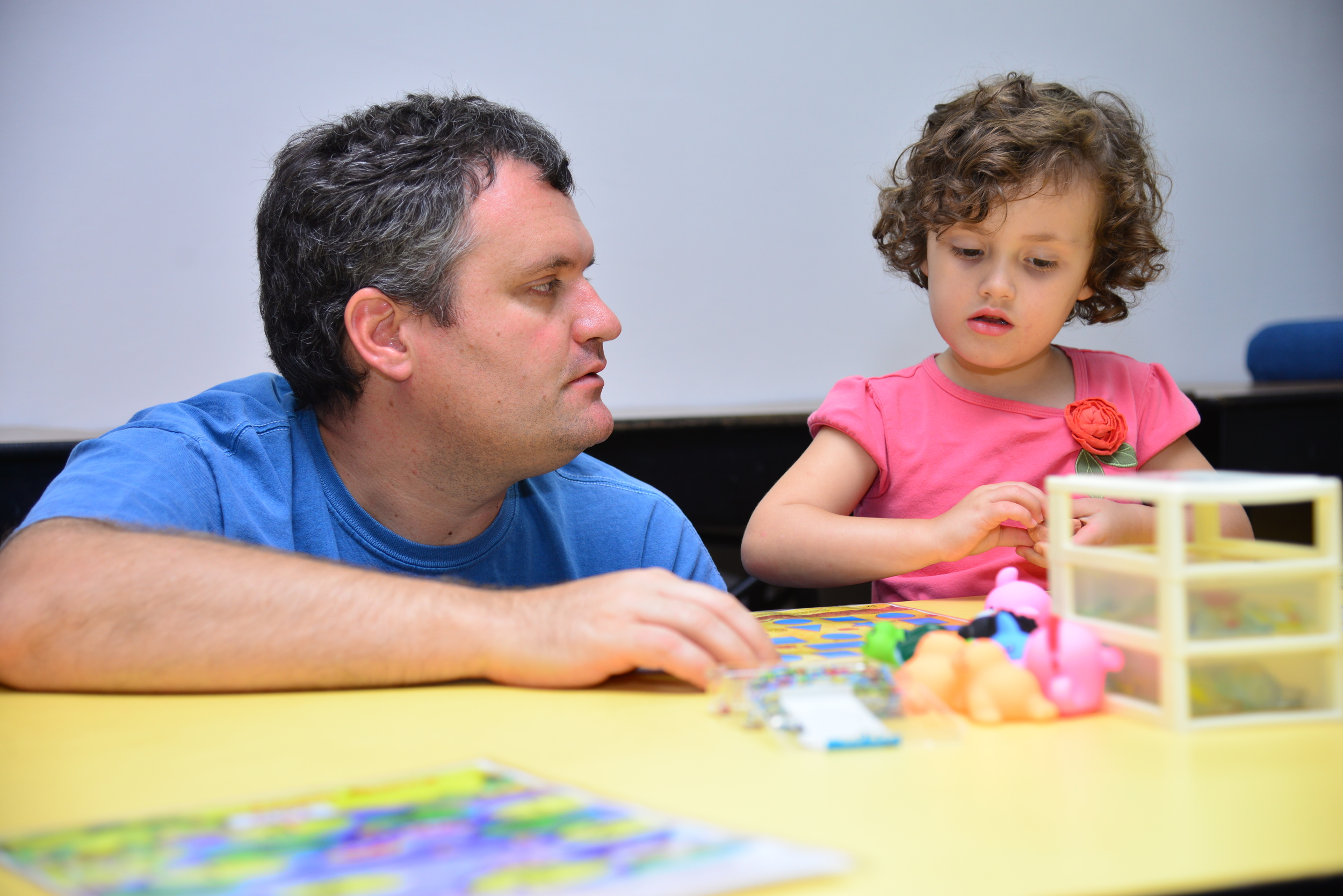 Daddy Andrew working with daughter Abigail.