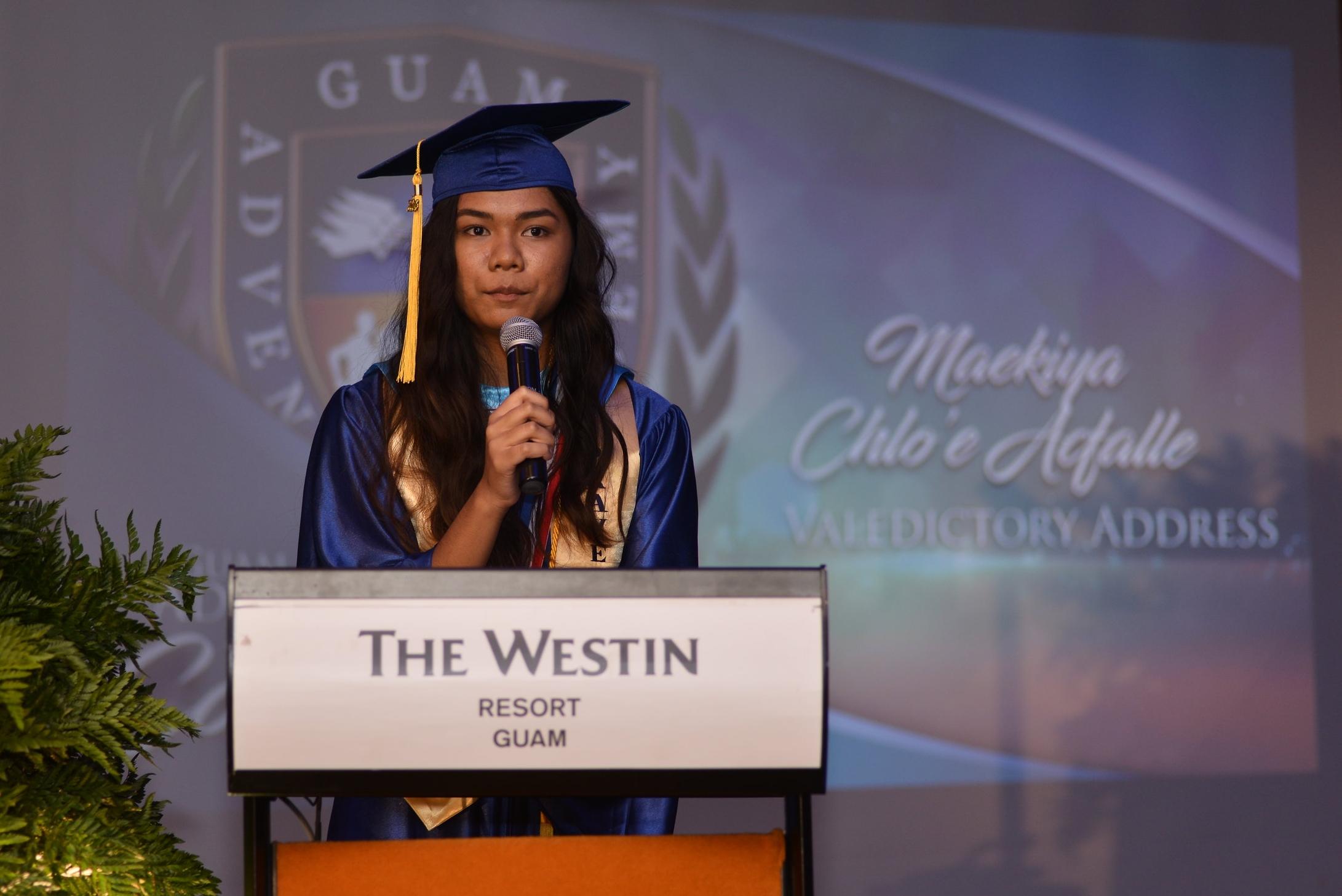 Valedictorian Maekiya Acfalle shares her valedictory message during the graduation ceremony.