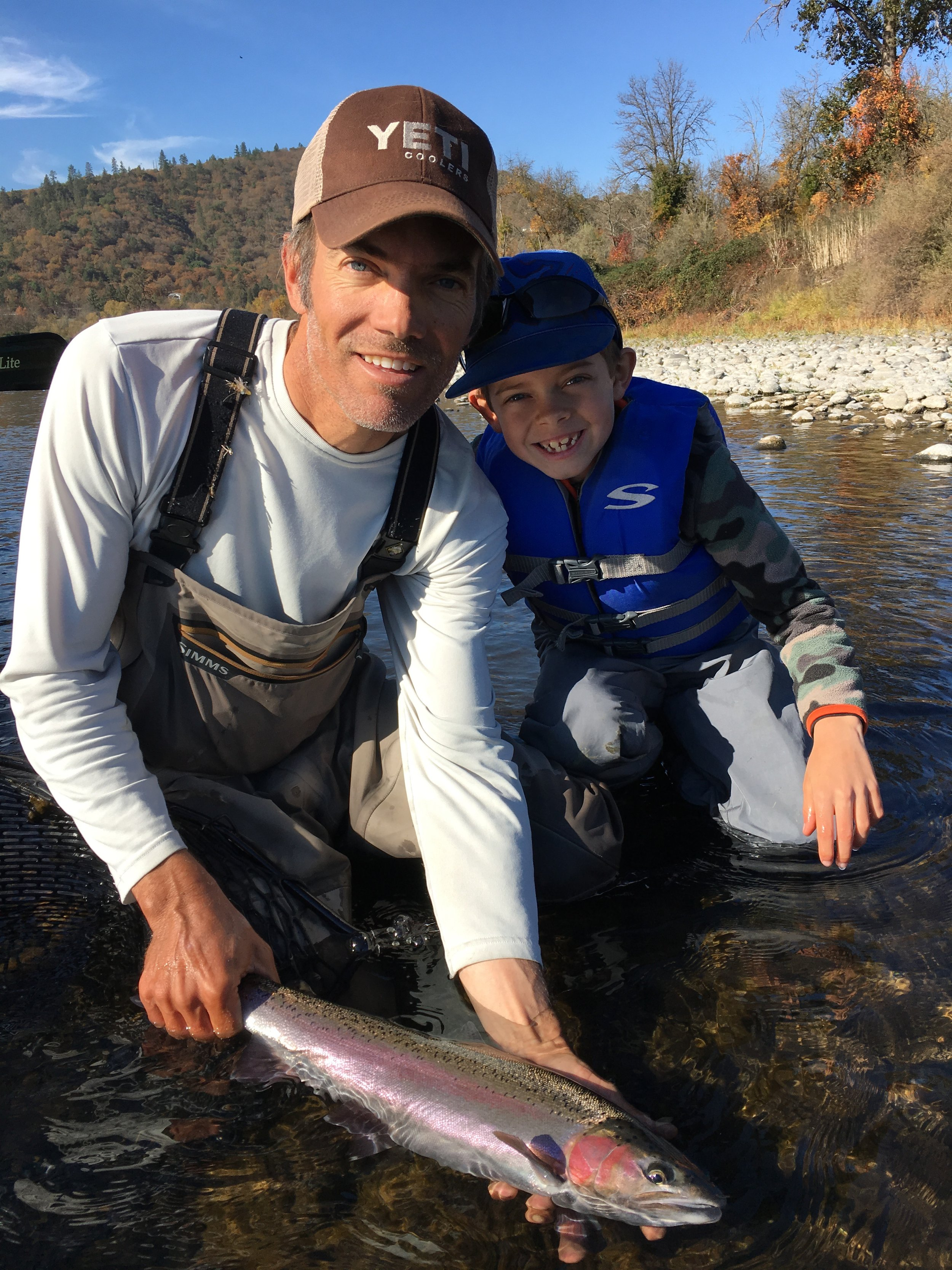 Jim Andras, Fly Fishing Guide, and son with nice Rogue River steelhead