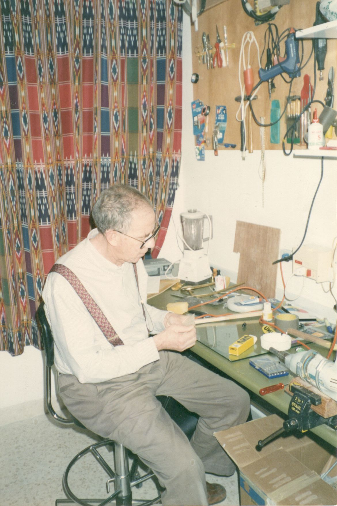 Usama tinkering in his workshop
