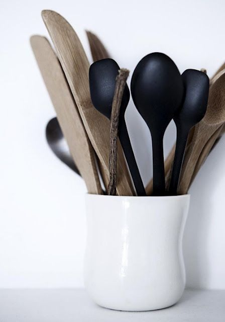 Purchase some simple items to give your space a new look. Keep the colour palatte nuetral and timeless. Match utensils and have them on display for easy access.