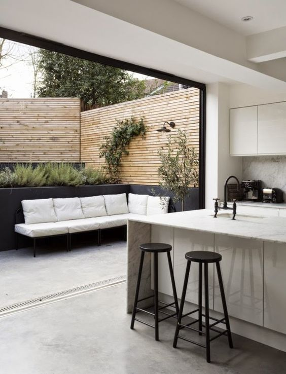 Timber, White seating and Dark Grey - layer your garden and connect it to the interior by using a seamless floor