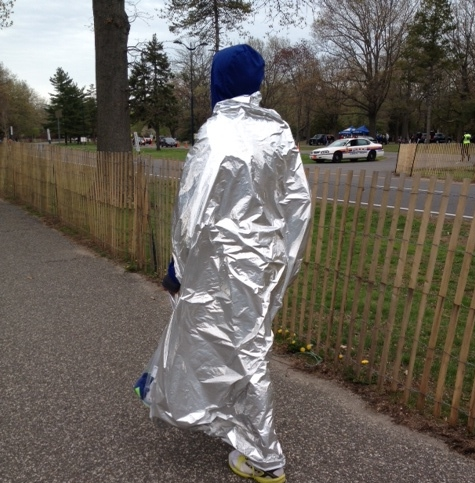 #5. Full body space blankets. If you weren't wearing one of these shiny trench coats you were simply out of style. This dude gave it an extra boost with the navy Eminem hood.