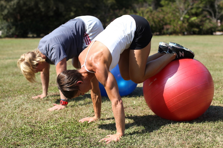 Core work on a fitness ball compliments STEELHOSE skills training. Here I'm workingwith clients on form and stability.