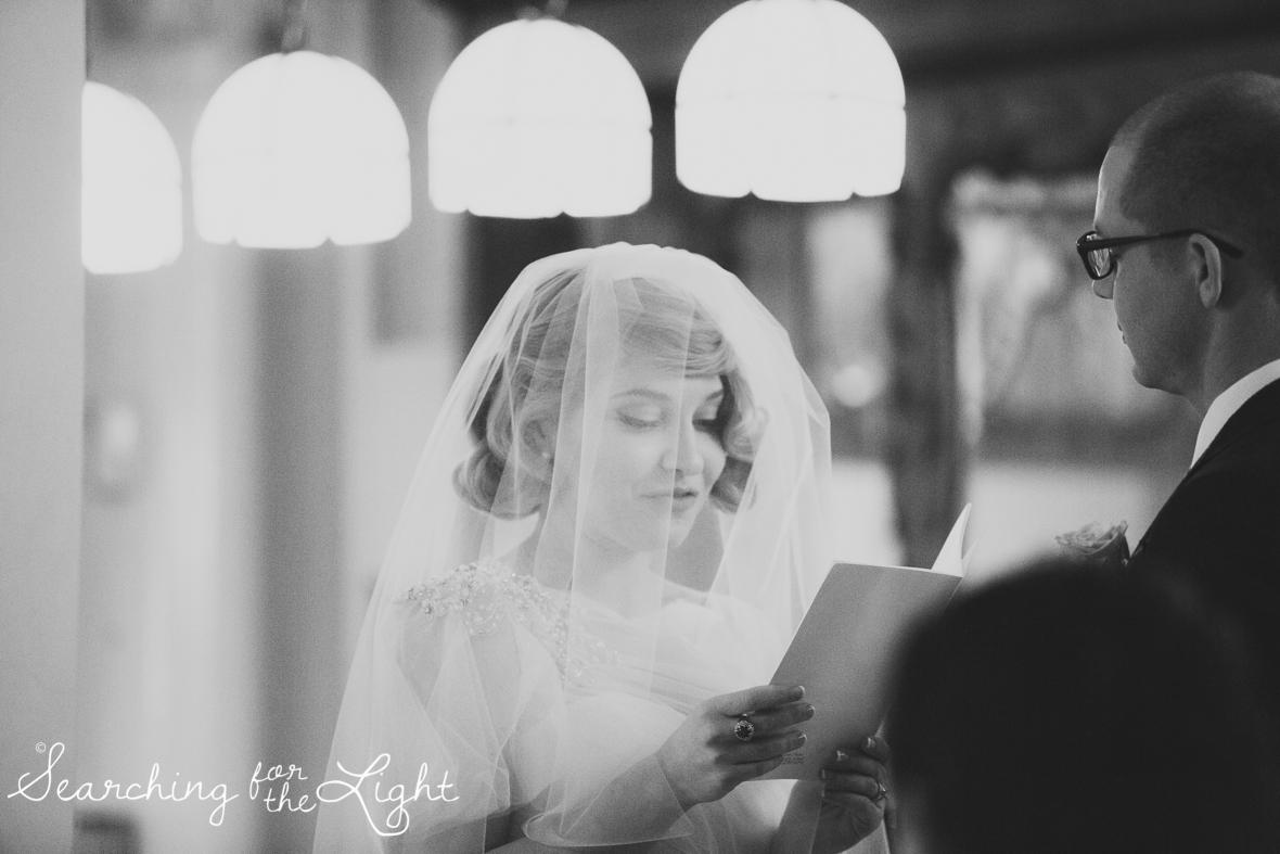 reading wedding vows indoor ceremony at Parkside mansion wedding photo by denver wedding photographer, romantic evening wedding photo, city wedding