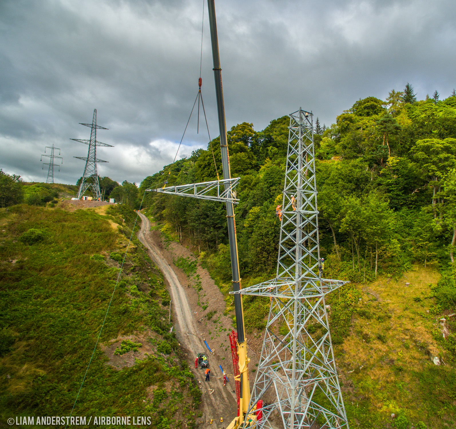 Engineers complete the topping out of the last pylon on the side of the Ochils near Stirling.