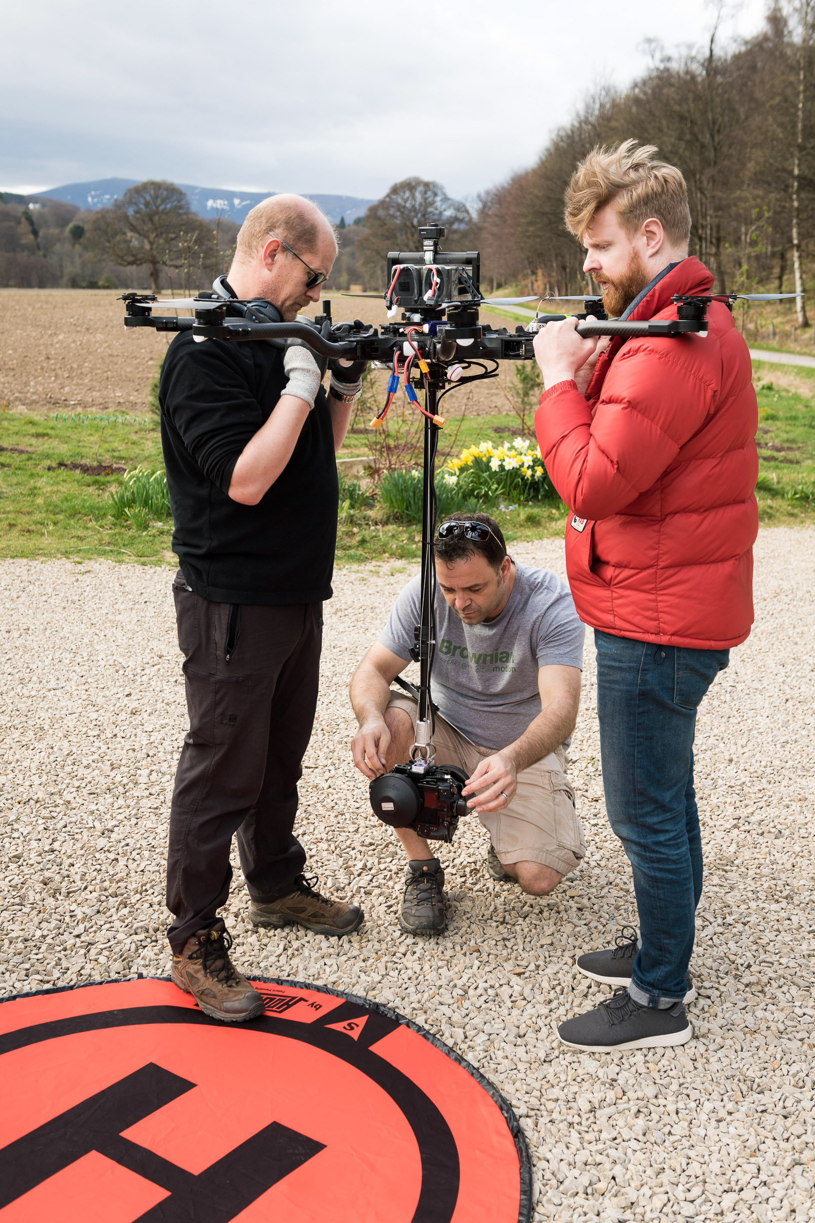 The team setting up the Alta 8 Freefly, preparing the camera's before take-off.