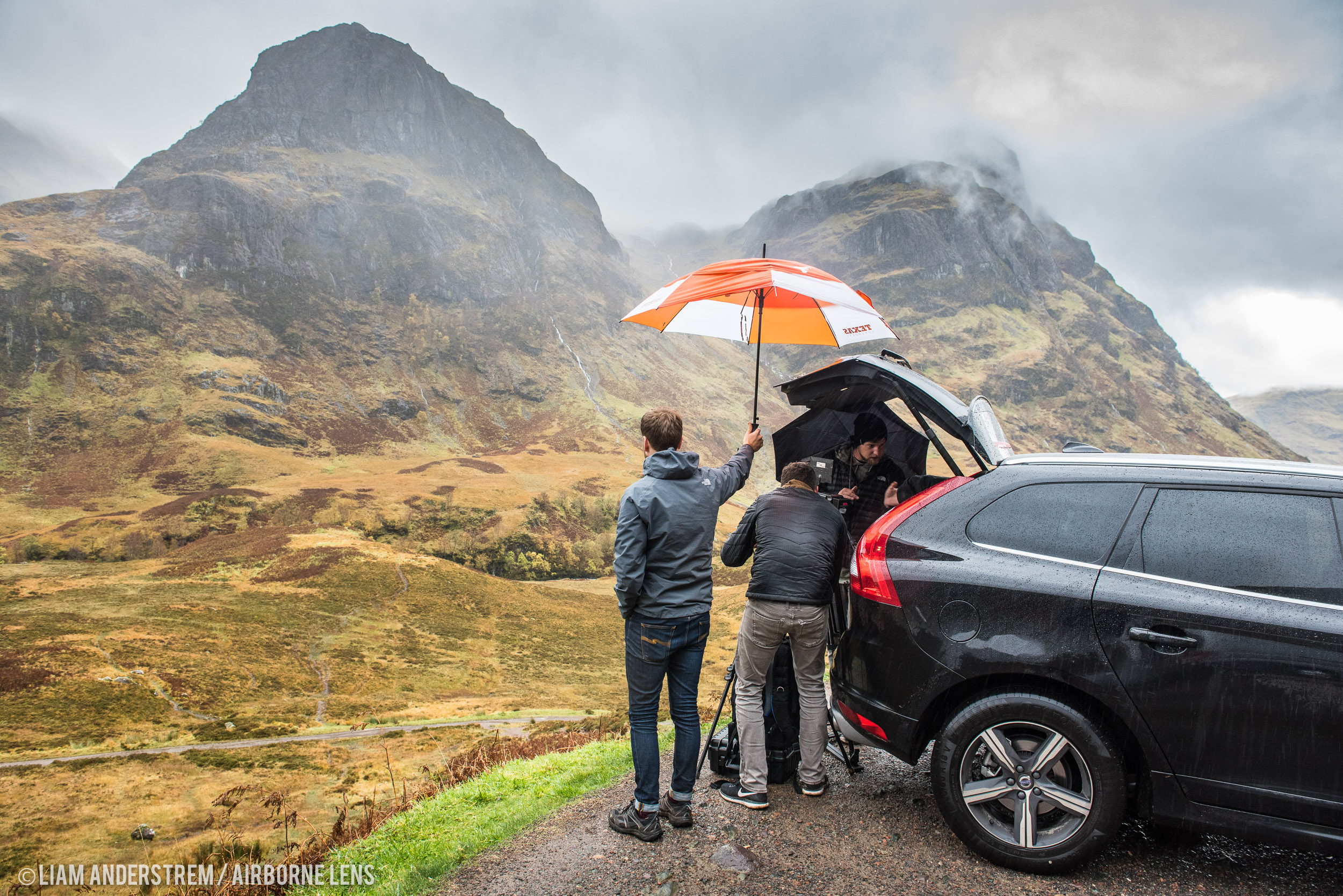 Sheltering from the rain while shooting in stunning Glencoe. The Texas umbrella is Liam's! Image Liam Anderstrem / Airborne Lens