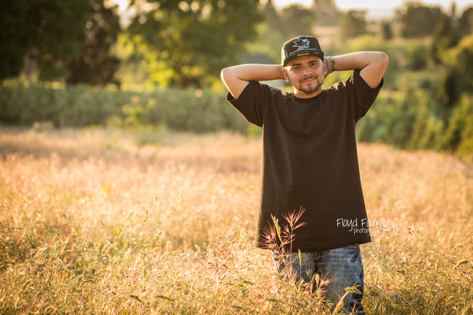 Senior boy standing in field with arms raised | Placerville-Children-Photographer