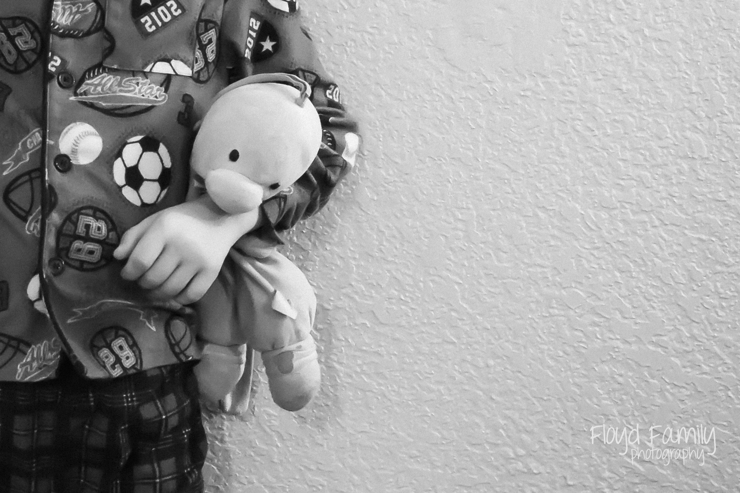 boy standing in pajamas holding lovey | Placerville-Children-Photos