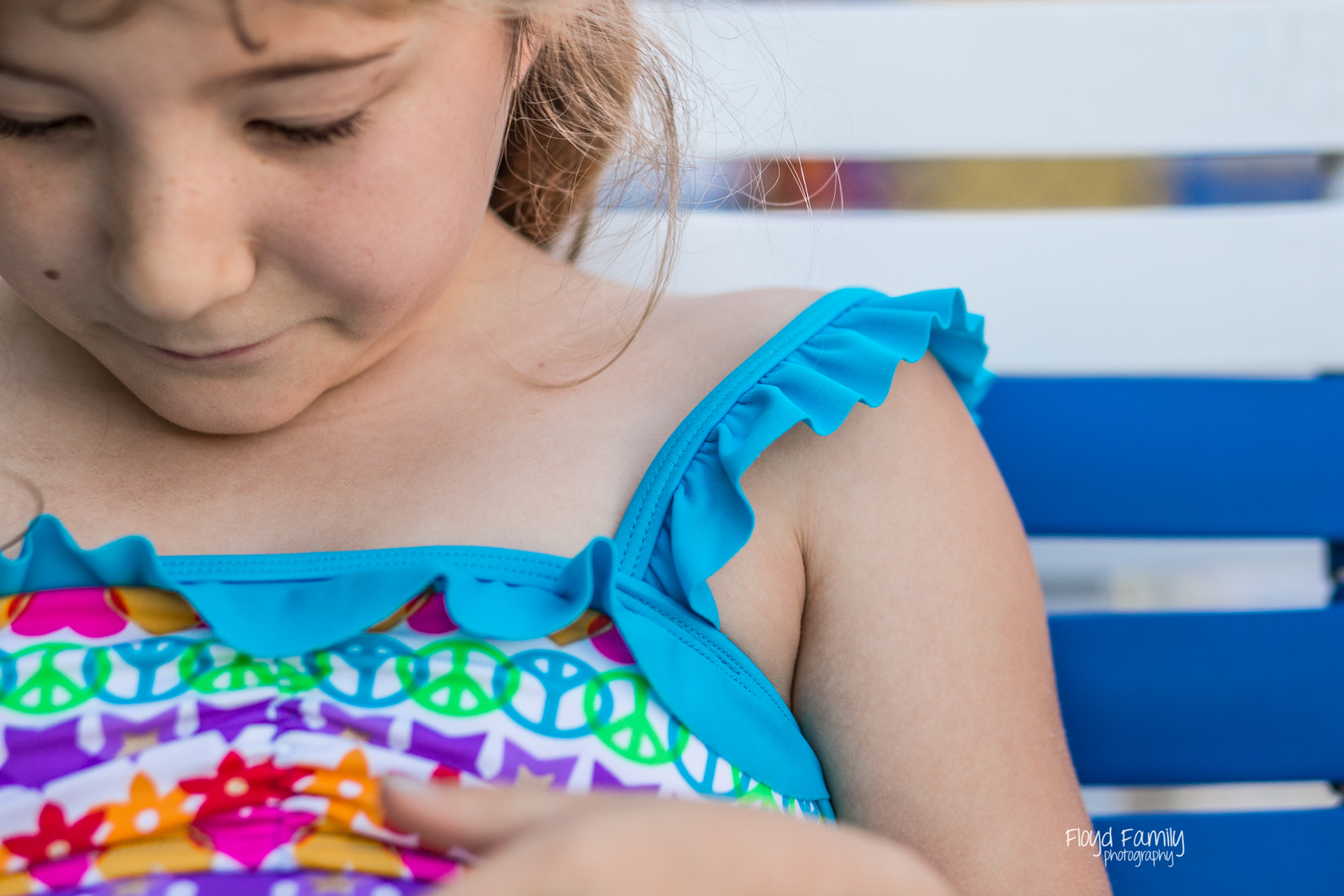 blue swimming suit sitting in chair on a summer day | Placerville-Children-Portraits