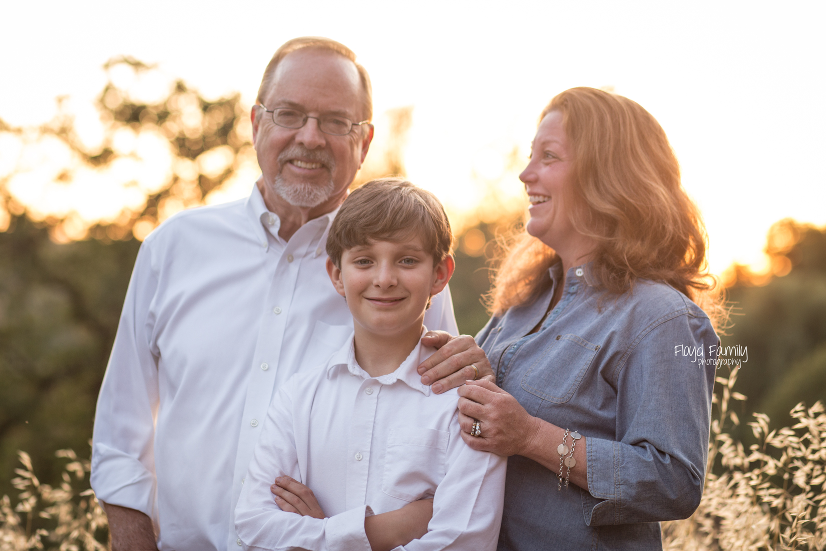 Family of three laughing backlit in a field | Placerville-Children-Photography
