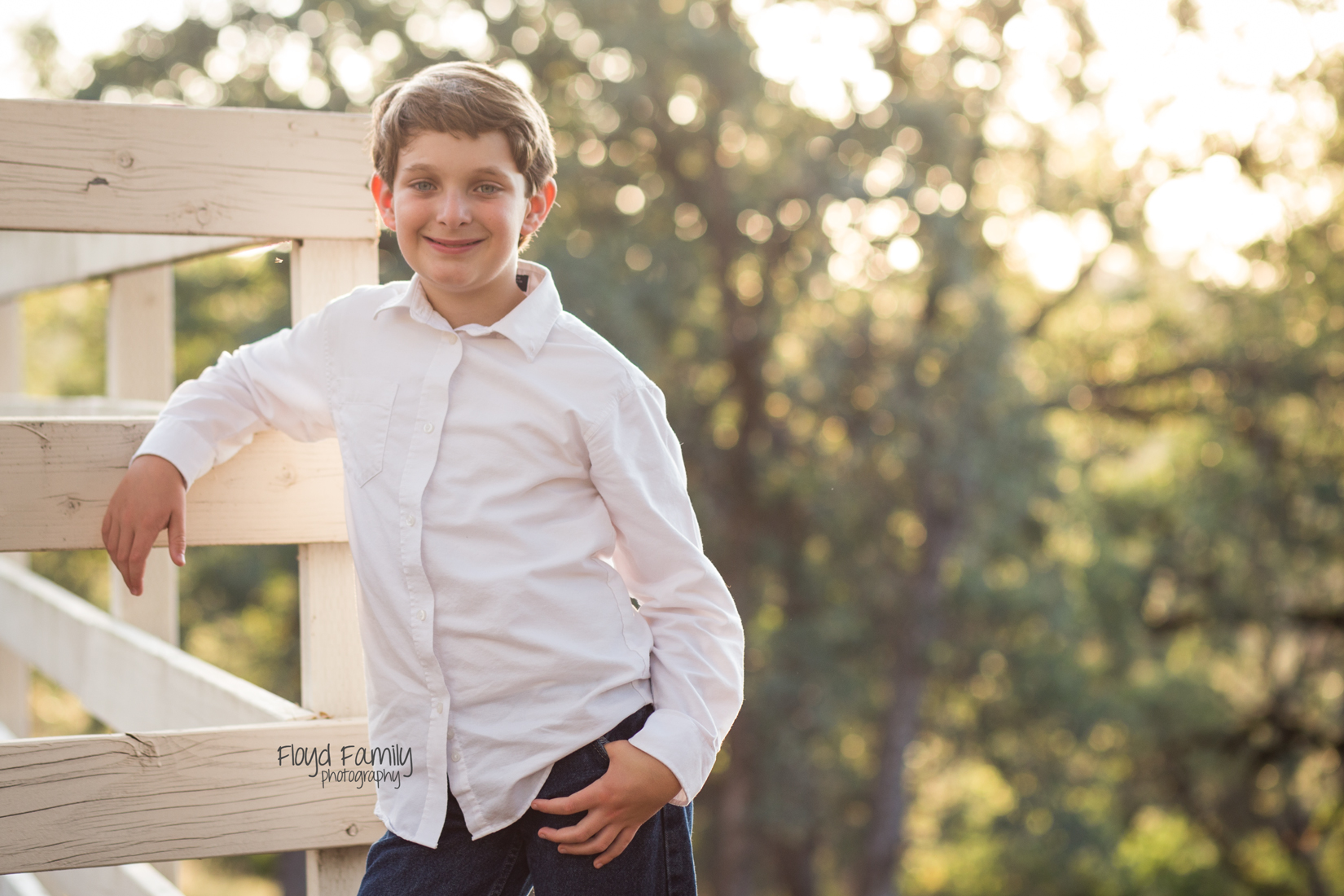 young boy backlit leaning on fence | Placerville-Children-Photography