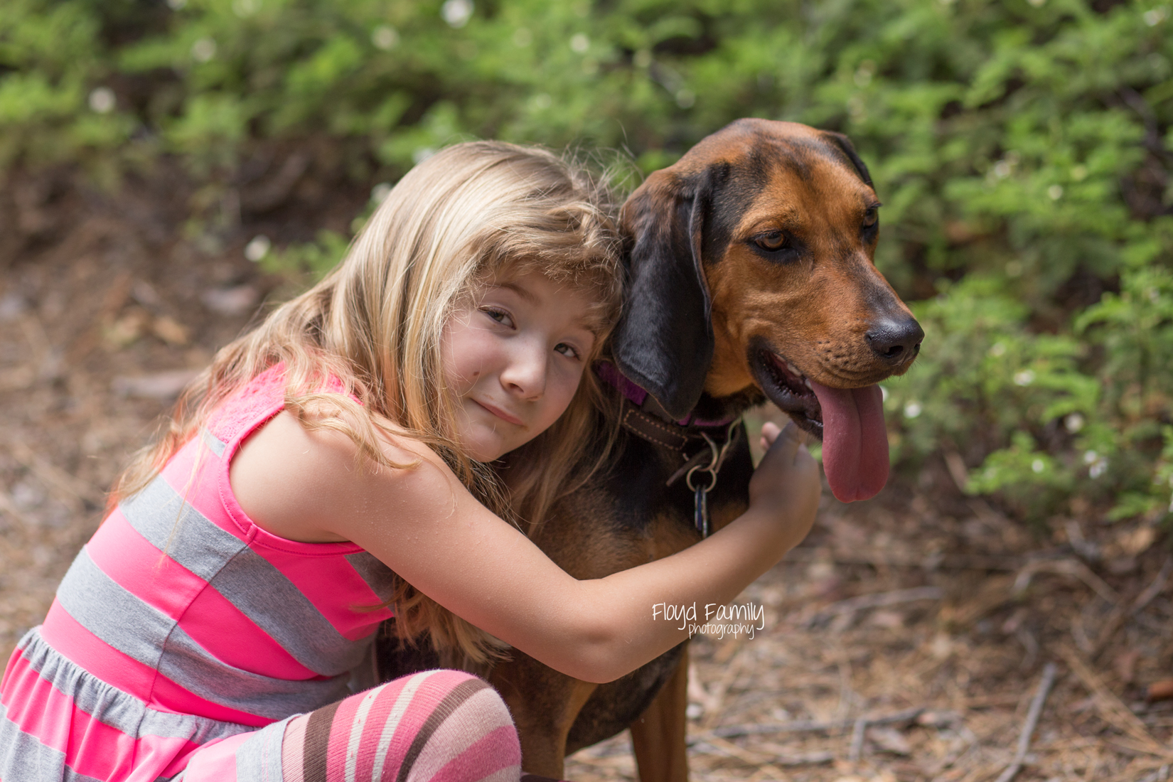girl sitting with dog on trail | Placerville-Family-Photos