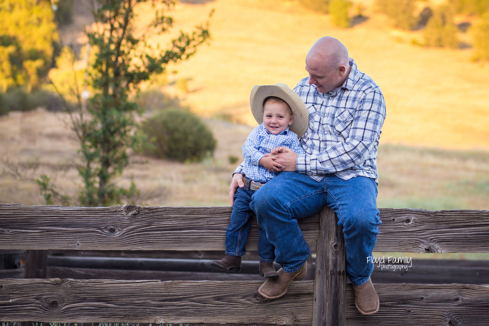 Father and son sitting on the top of wood fence | Placerville Documentary Family Photography