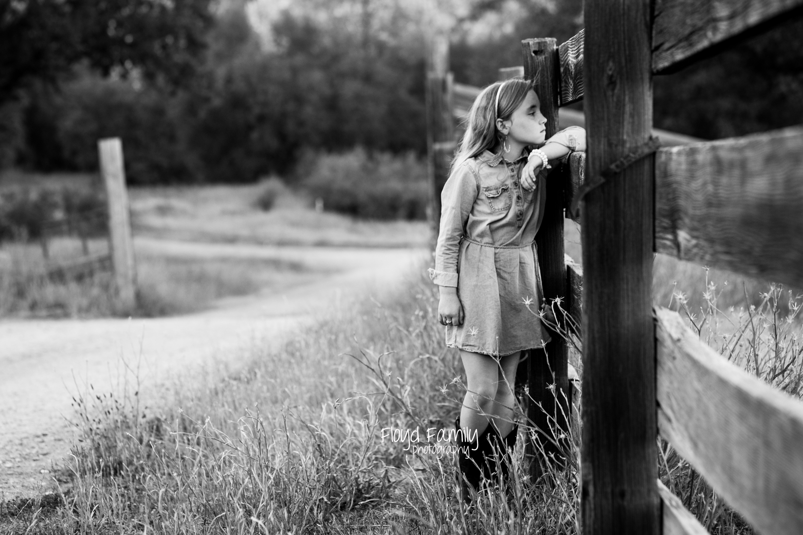 Girl standing on the side of wood fence | Placerville Documentary Family Photography