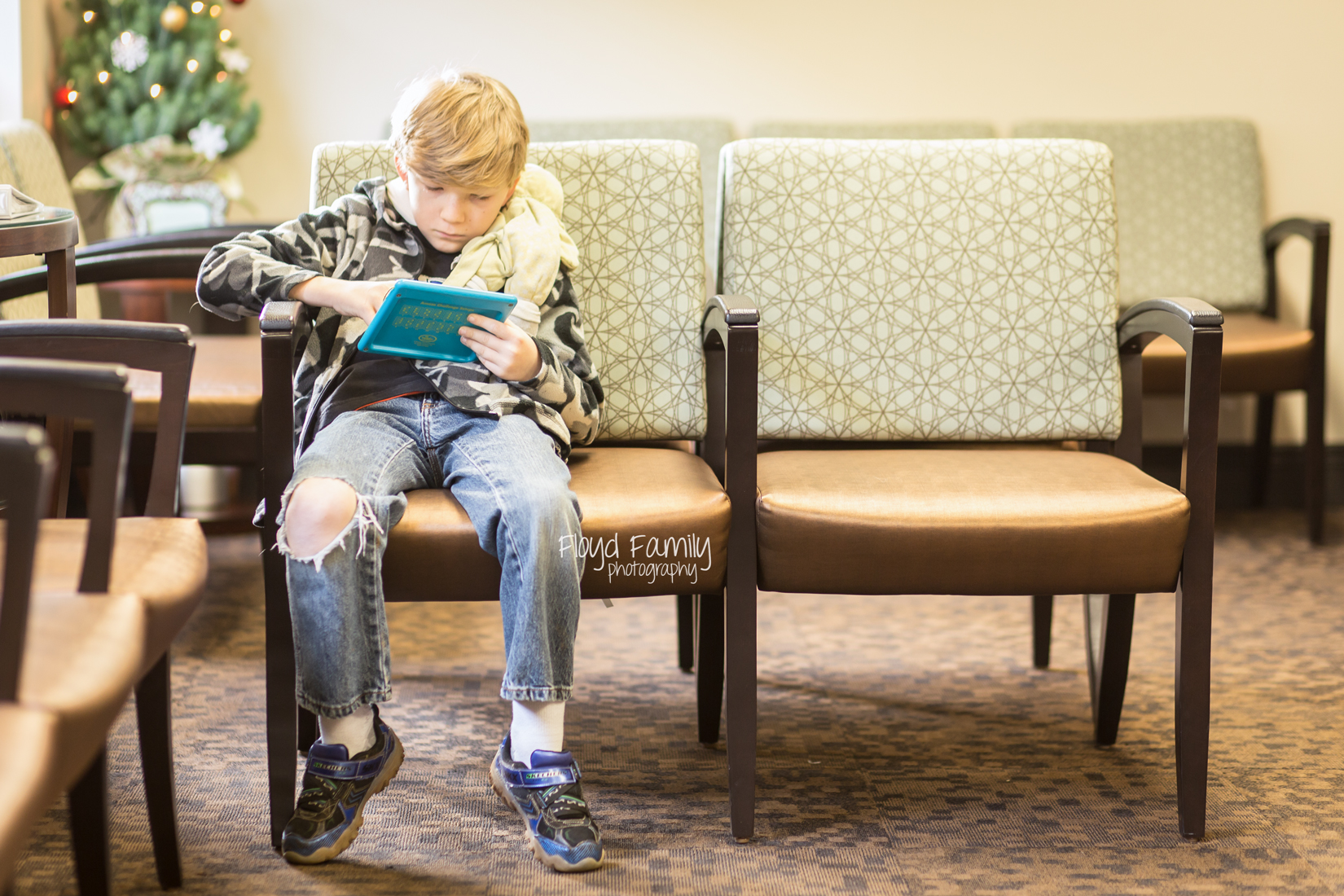boy playing game in waiting room | Placerville Lifestyle Documentary Photos