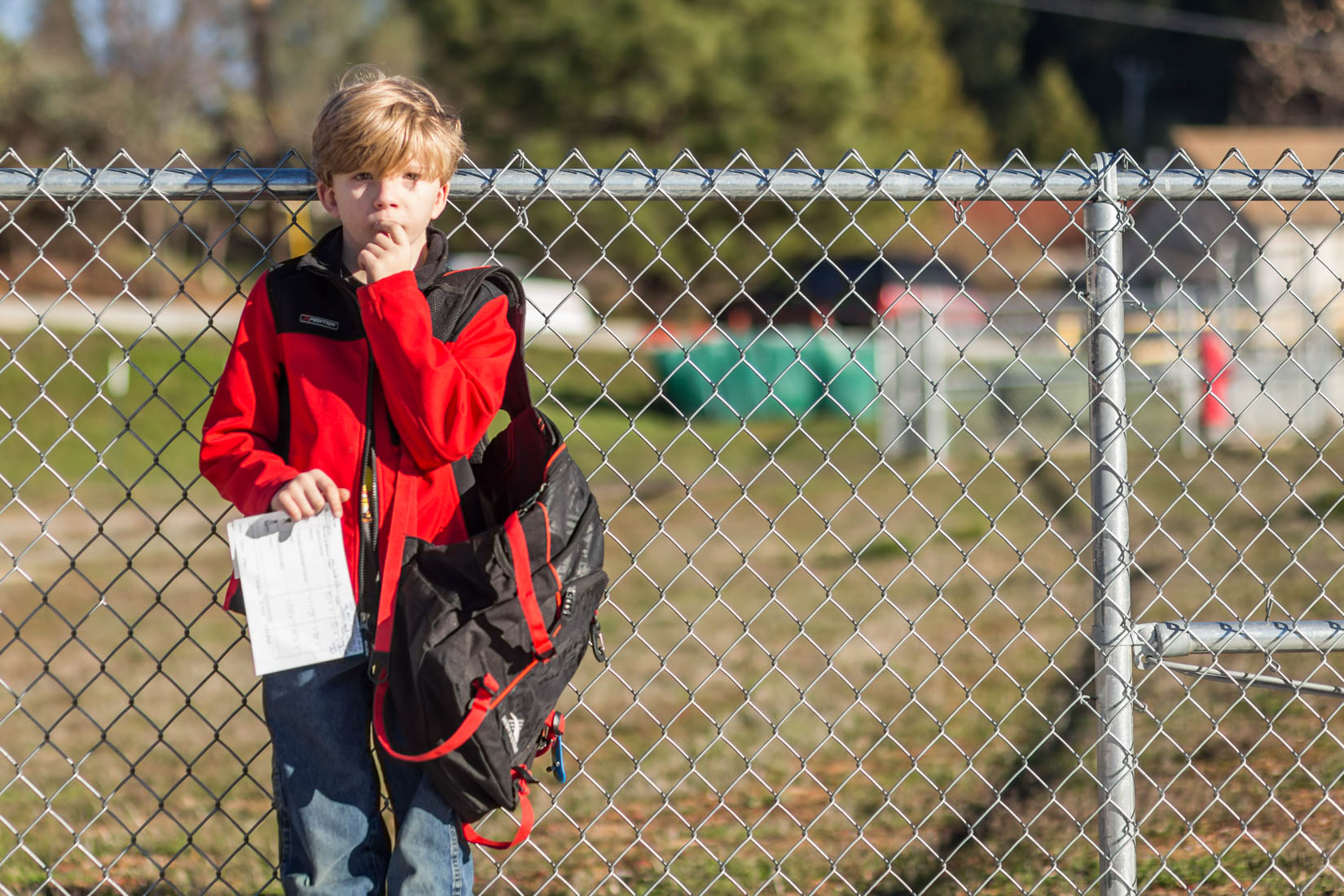 First day of school boy in front of fence