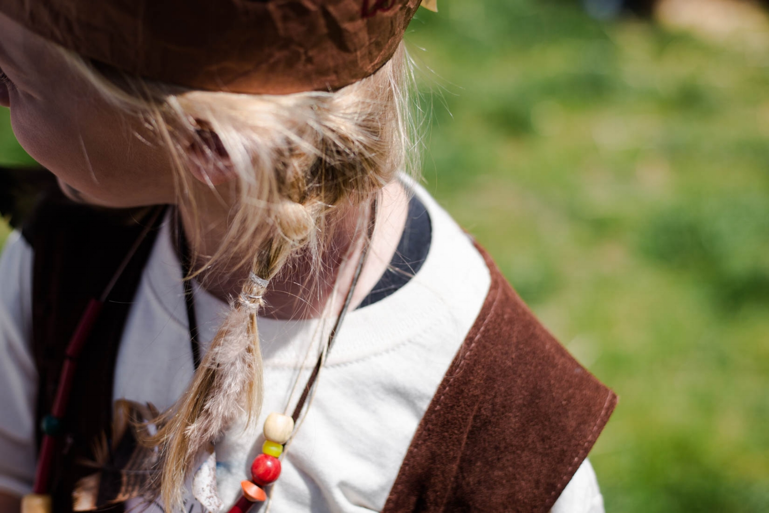 Young girl with braids in her hair wearing Native American Clothing | El Dorado Hills Photographer Children