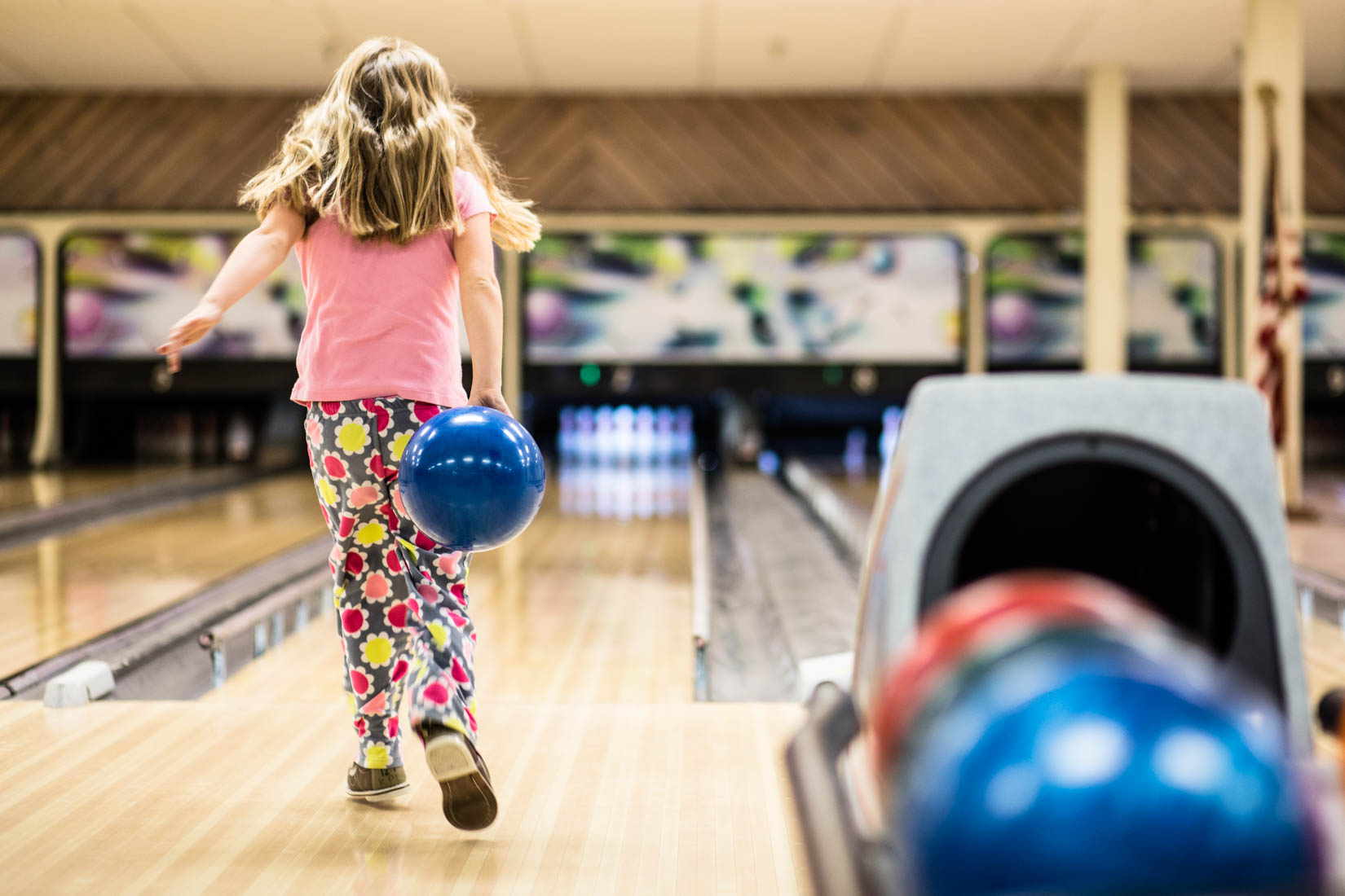 Young girl bowling her pajamas