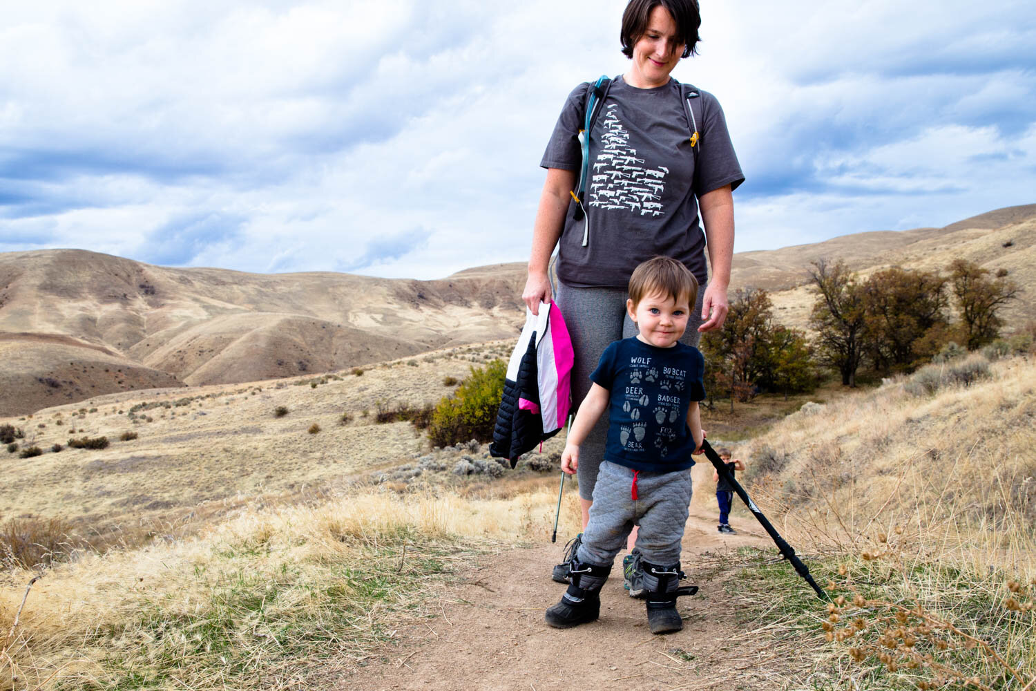 Mom and daughter hiking Homestead Trail in Boise Idaho. Overlooking Boise foothills on a nice fall evening.