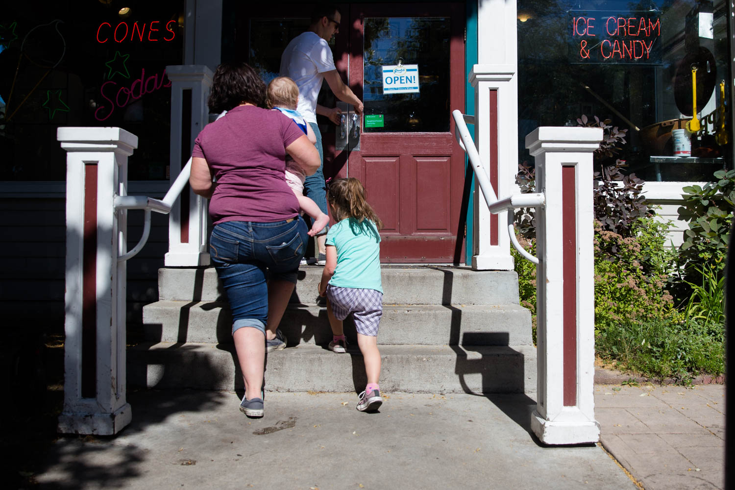 Walking into Goody's Soda Fountain to get themselves a treat, a family of four is excited at Hyde Park in Boise Idaho.