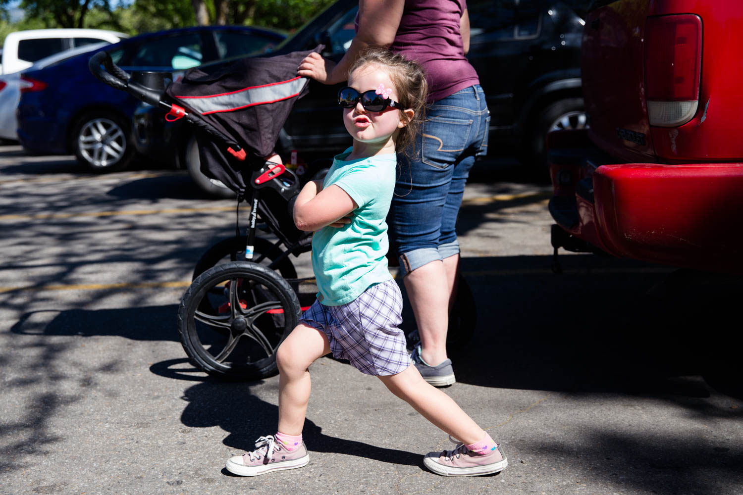 Little girl walking with determination as she goes down the street from Camelsback Park to Hyde Park in Boise on their way to the Goody's Soda fountain