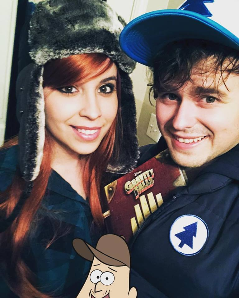 The lady and I on Halloween this year! (With surprise guest: Soos.)