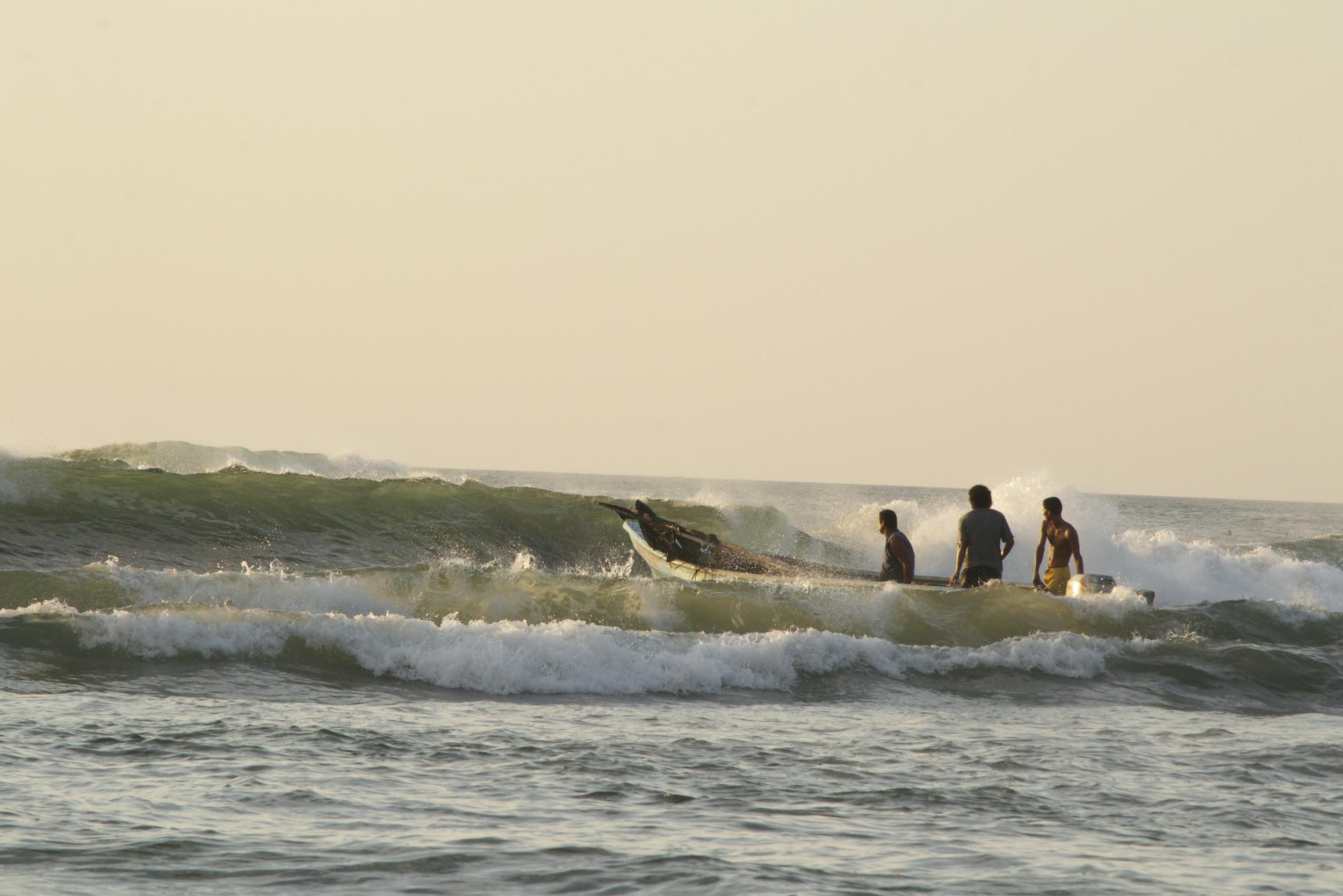 fisher men in waves.jpg