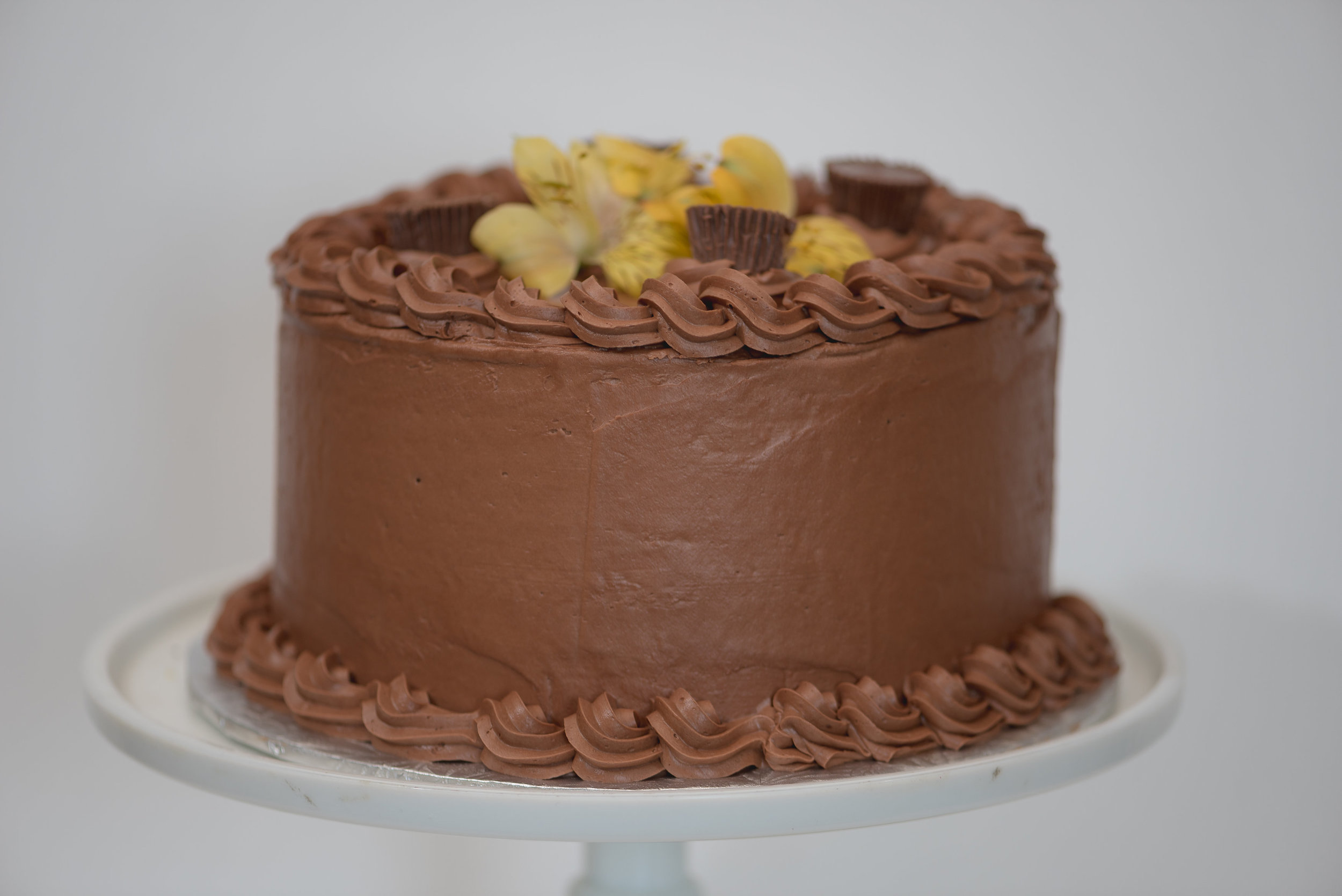 Double chocolate peanut butter cup cake.fresh flowers not included
