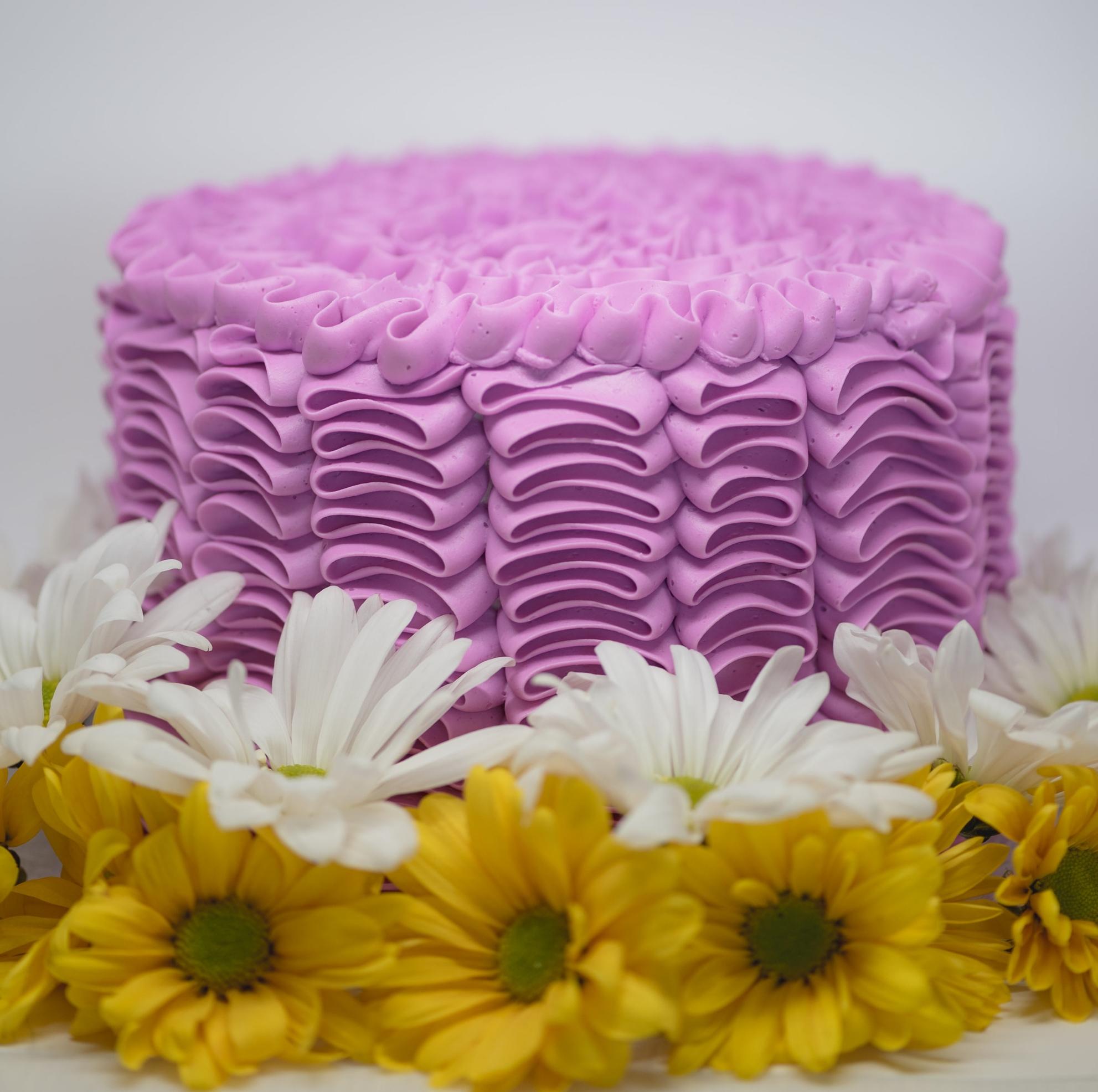 Buttercream vertical ribbon cake. Fresh flowers not included