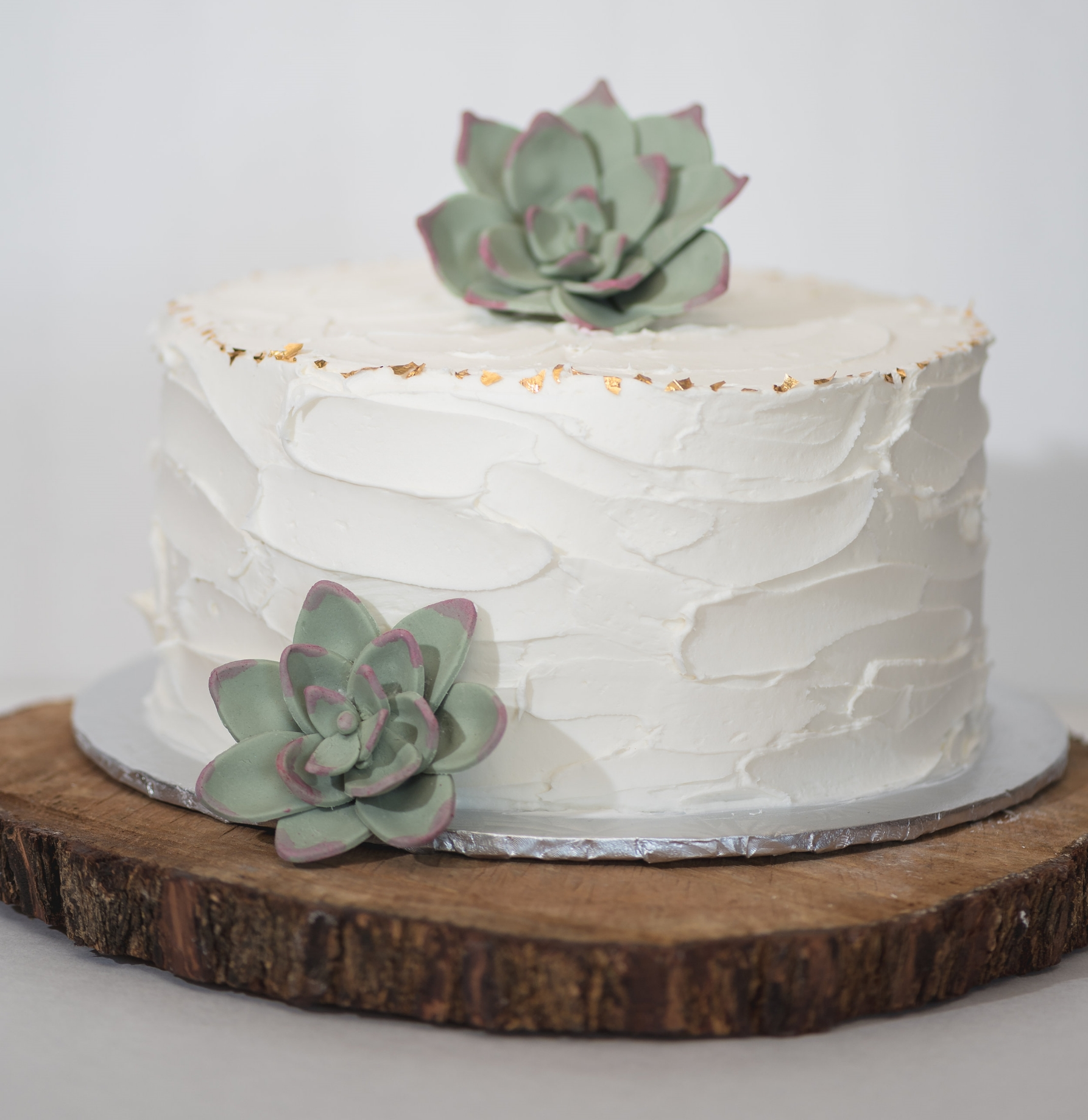 Rustic cake.Gold leaf and fondant succulents are additional