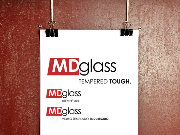 """Tempered tough  MD Glass' original logo dated back to the 1960s and was based on the title block found on technical drawings. 40 years later, they were ready to try something new. Our bolder, contemporary approach gave a respectful nod to their industry and its history and the to-the-point tagline we developed – """"Tempered tough."""" – was a clear winner for them. Our brand development comes in a trio of languages and  online presence ."""