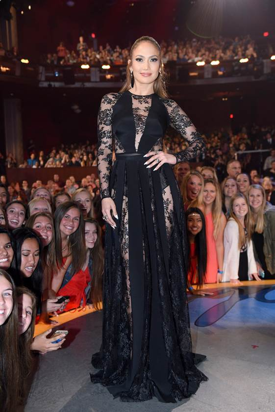 Jennifer Lopez was on hand for the American Idol Finale in Los Angeles while rocking a black sheer paneled gown from  Zuhair Murad's Fall 2015 Collection . The songstress effortlessly uplifted the sultry 'fit while keeping her accessories to a minimum.  Source : Style.com