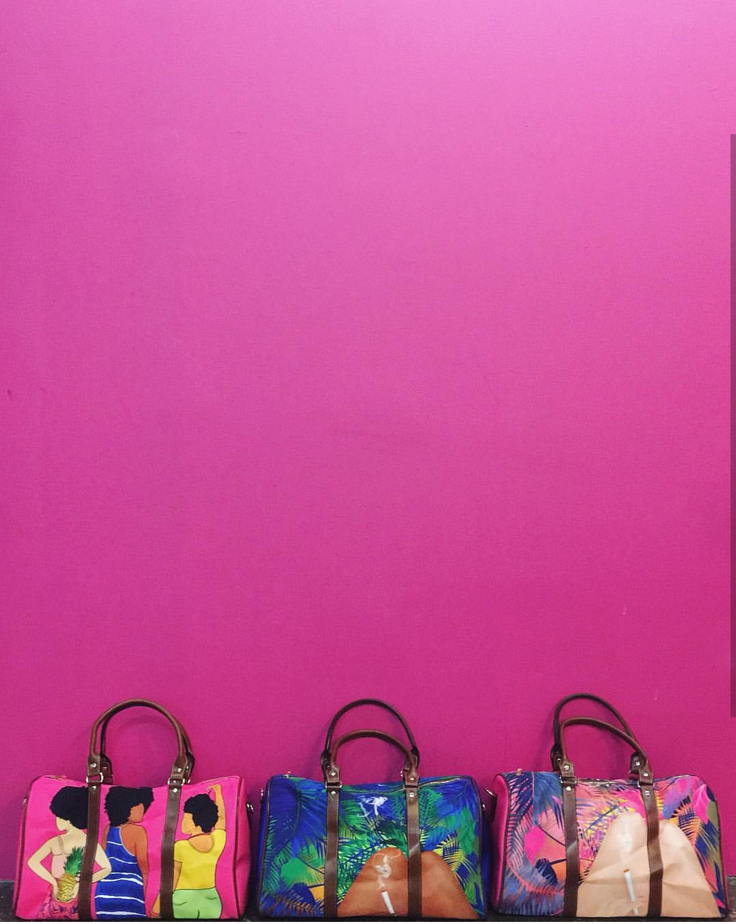 Bags against pink background.png