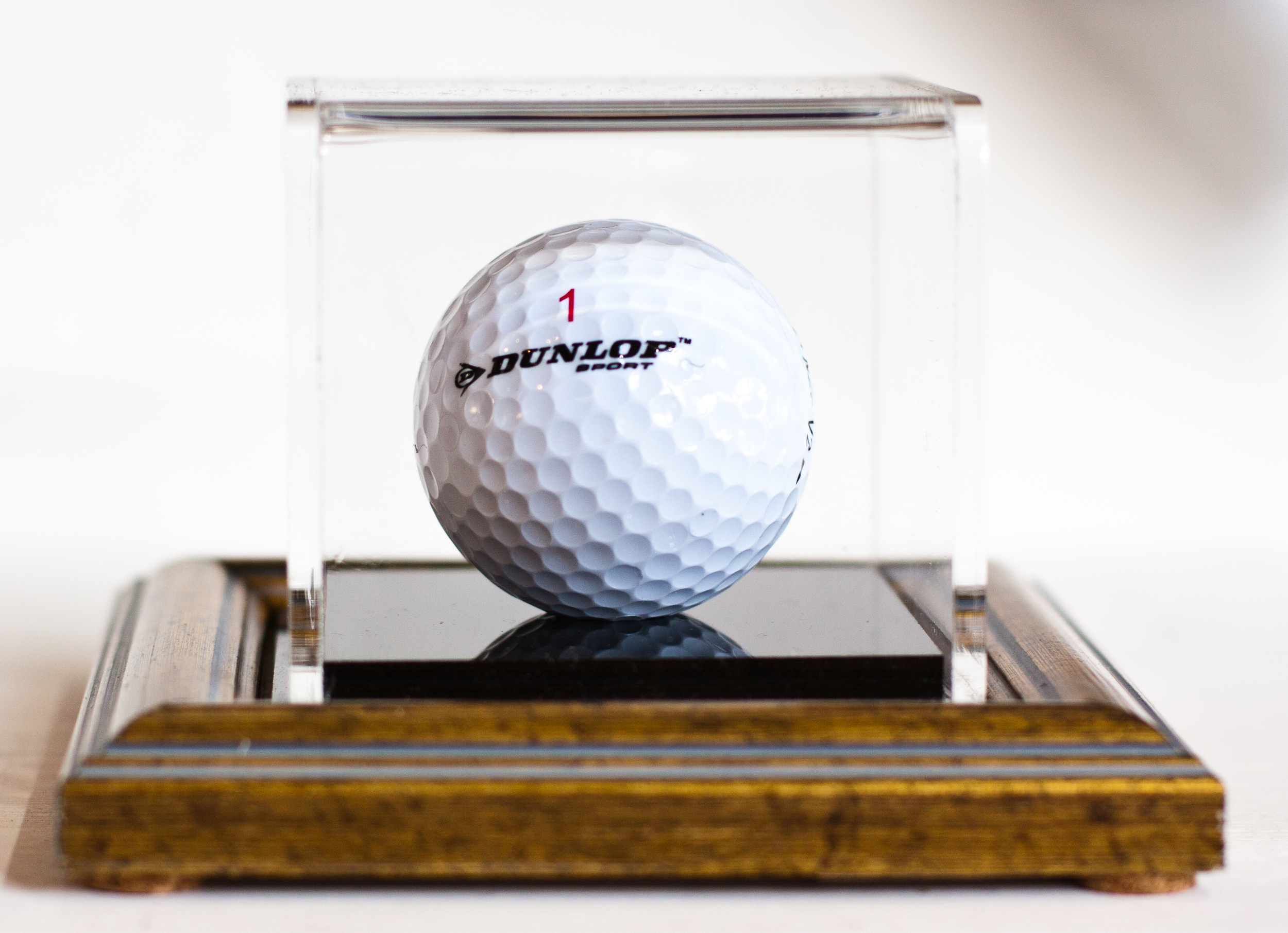 Golf ball displayed on 1900 old gold base