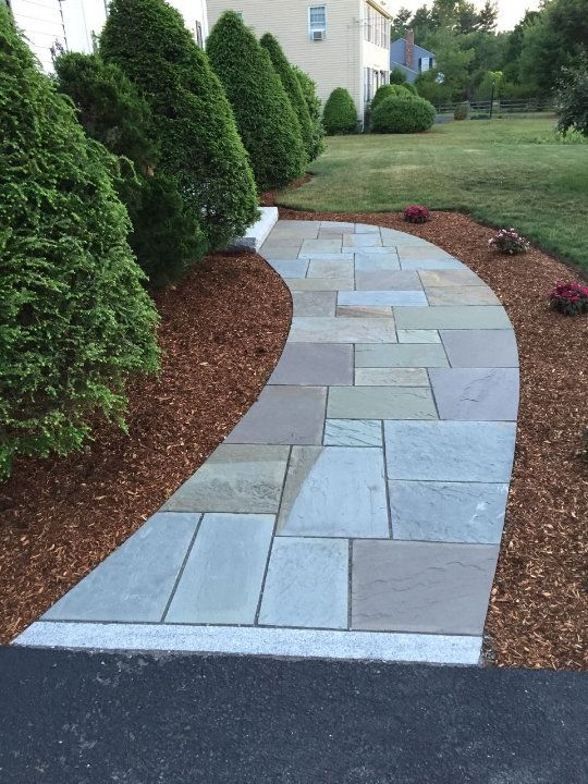 Sweeping full color bluestone walkway