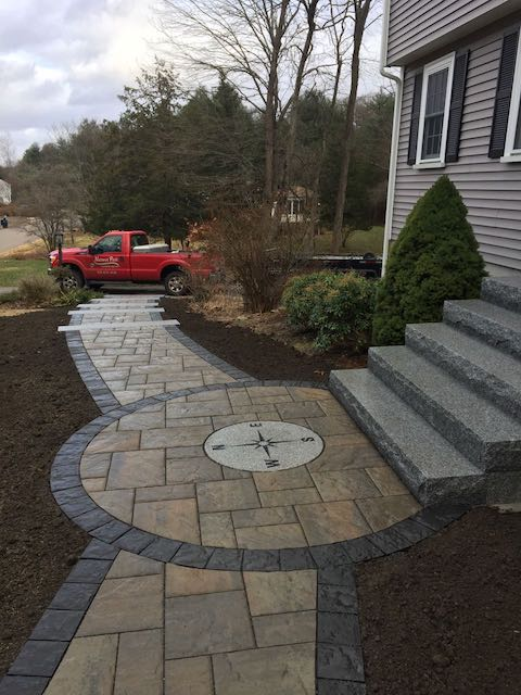 Permeable Walkway with Granite Compass.jpg